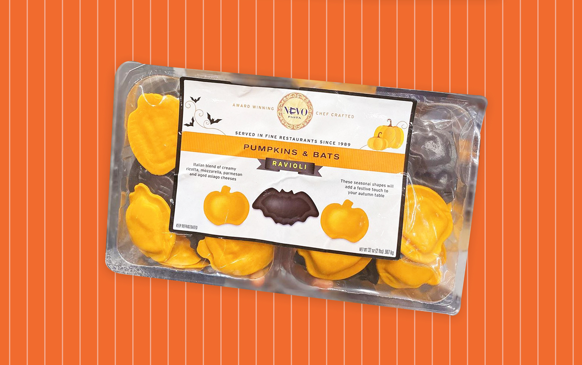 Costco package of pumpkin bat shaped cheese ravioli on orange background
