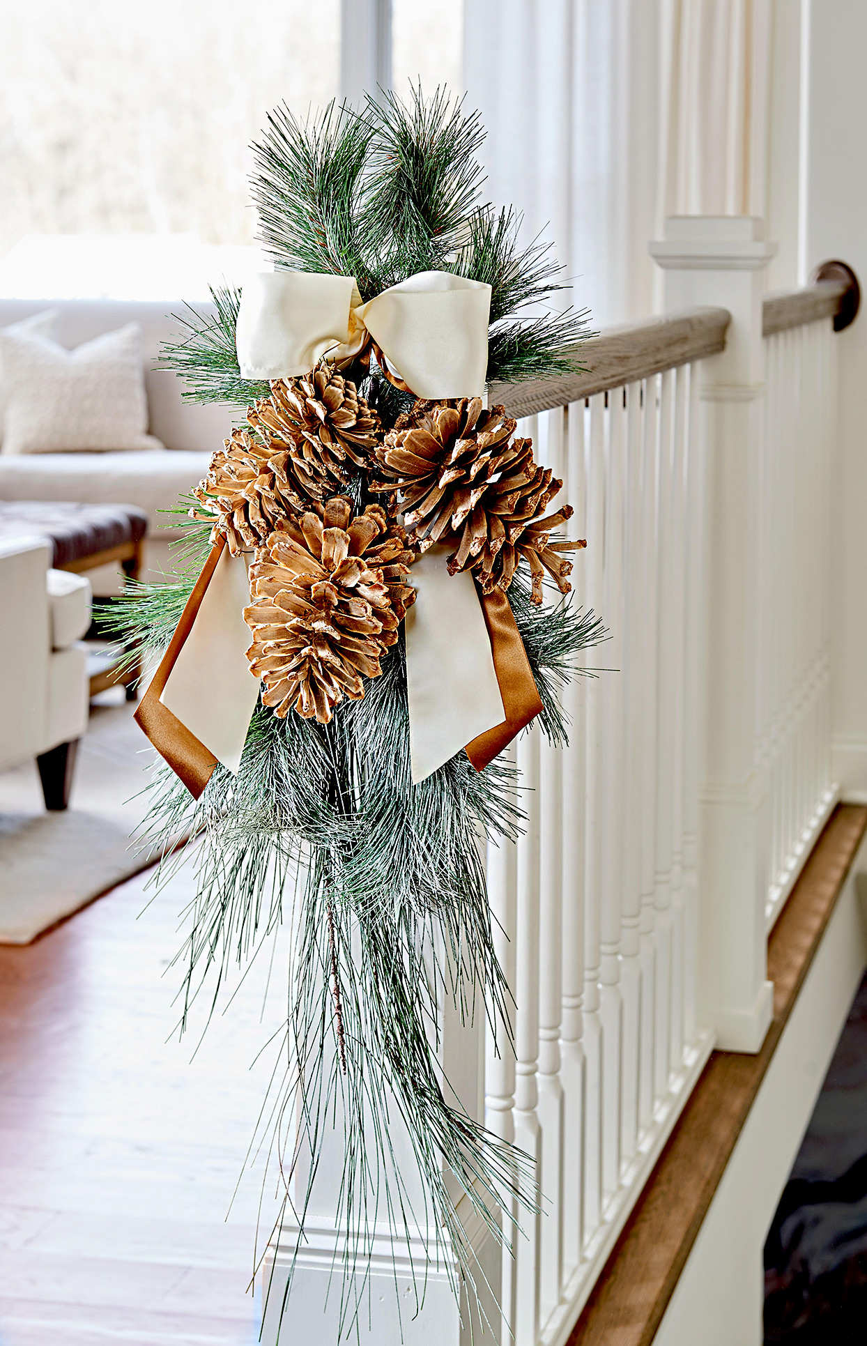 Bannister with evergreen and pinecone decoration