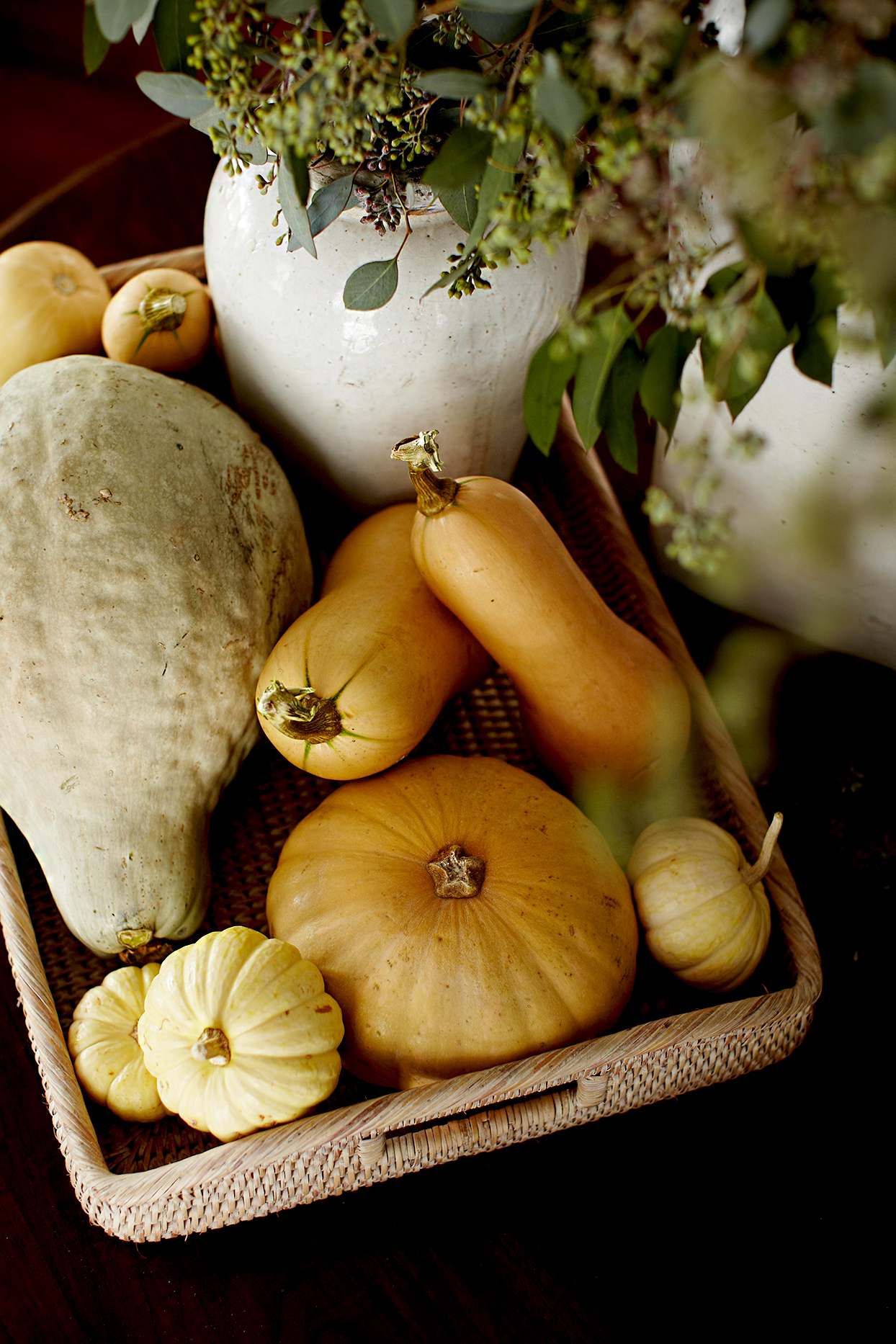Basket holding gourds and pumpkins