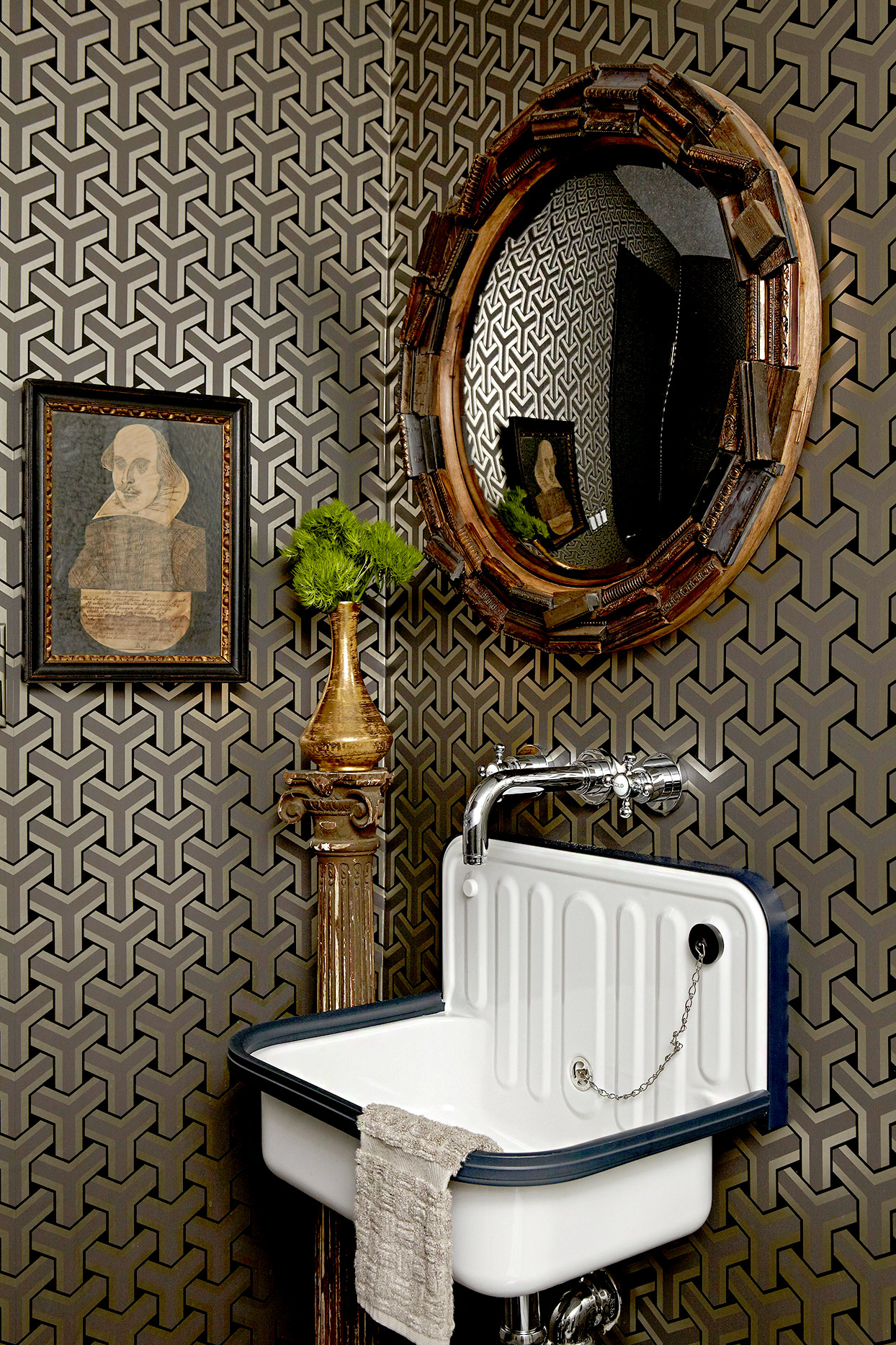 Bathroom with white sink, portrait, and mirror