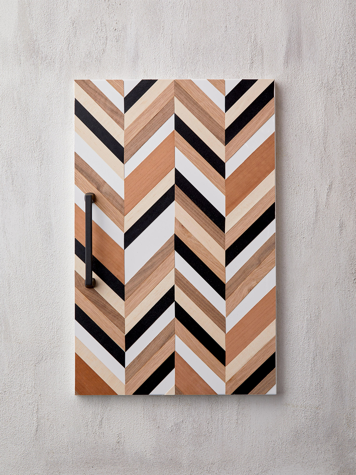 black, brown, and white chevron cabinet