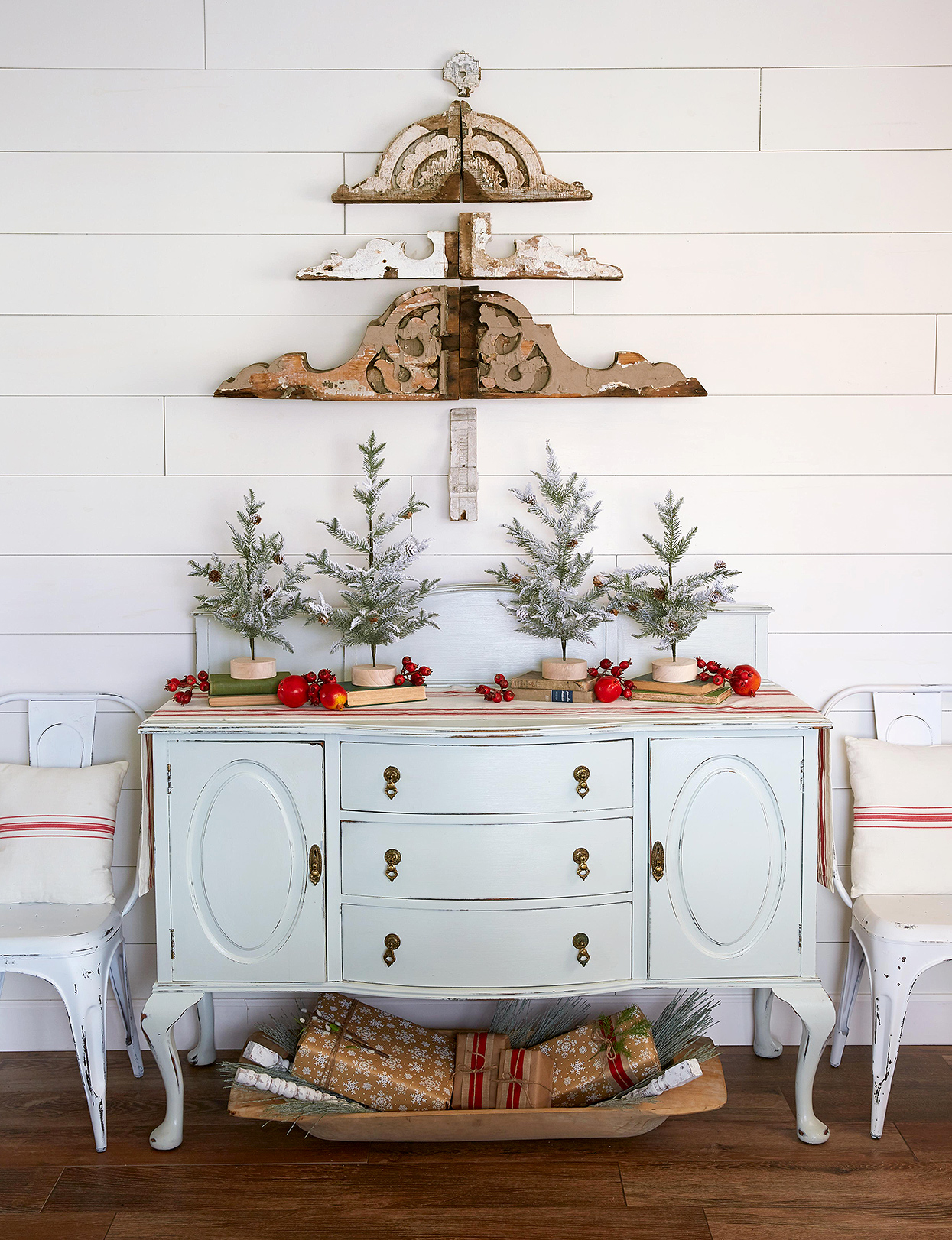 pale blue buffet with mini Christmas trees on display