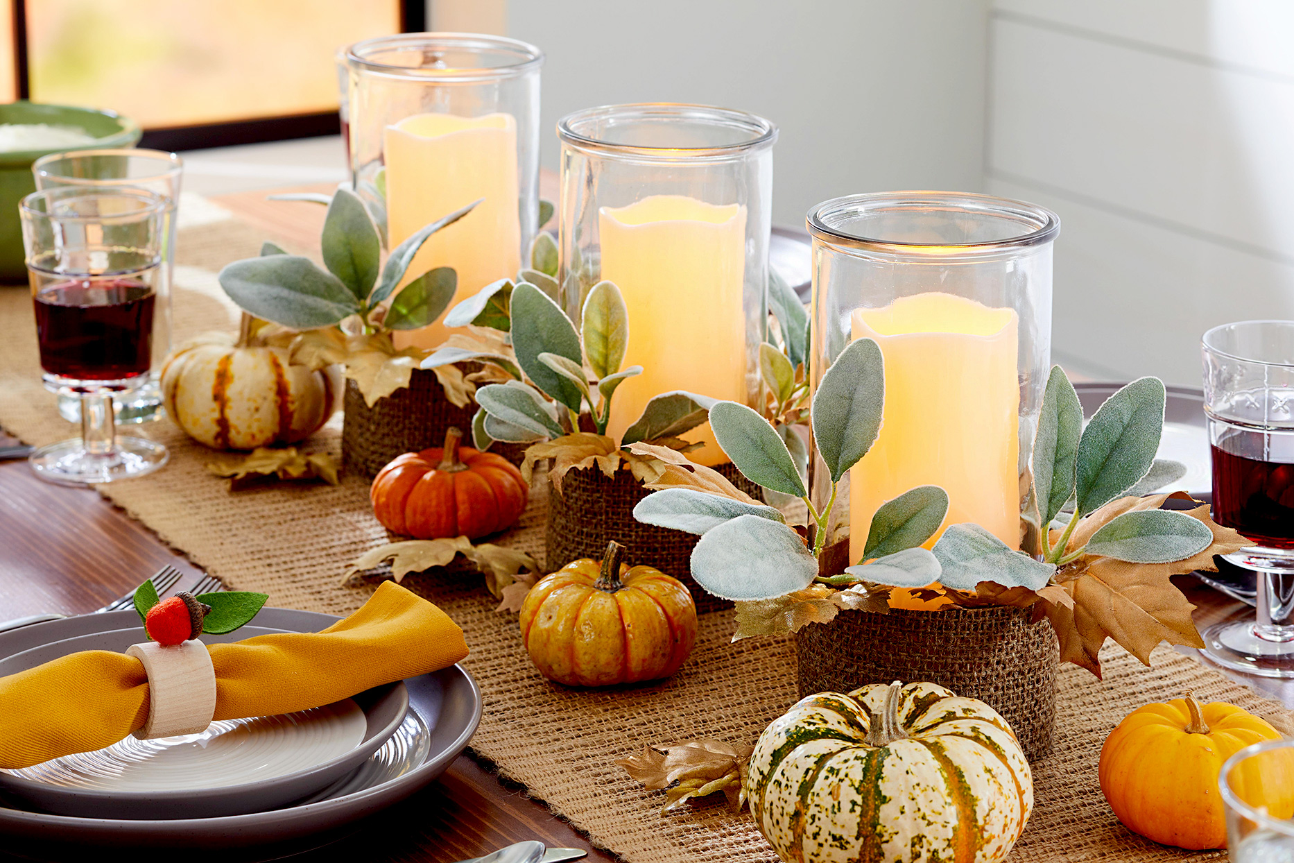 Centerpiece with candles and pumpkins