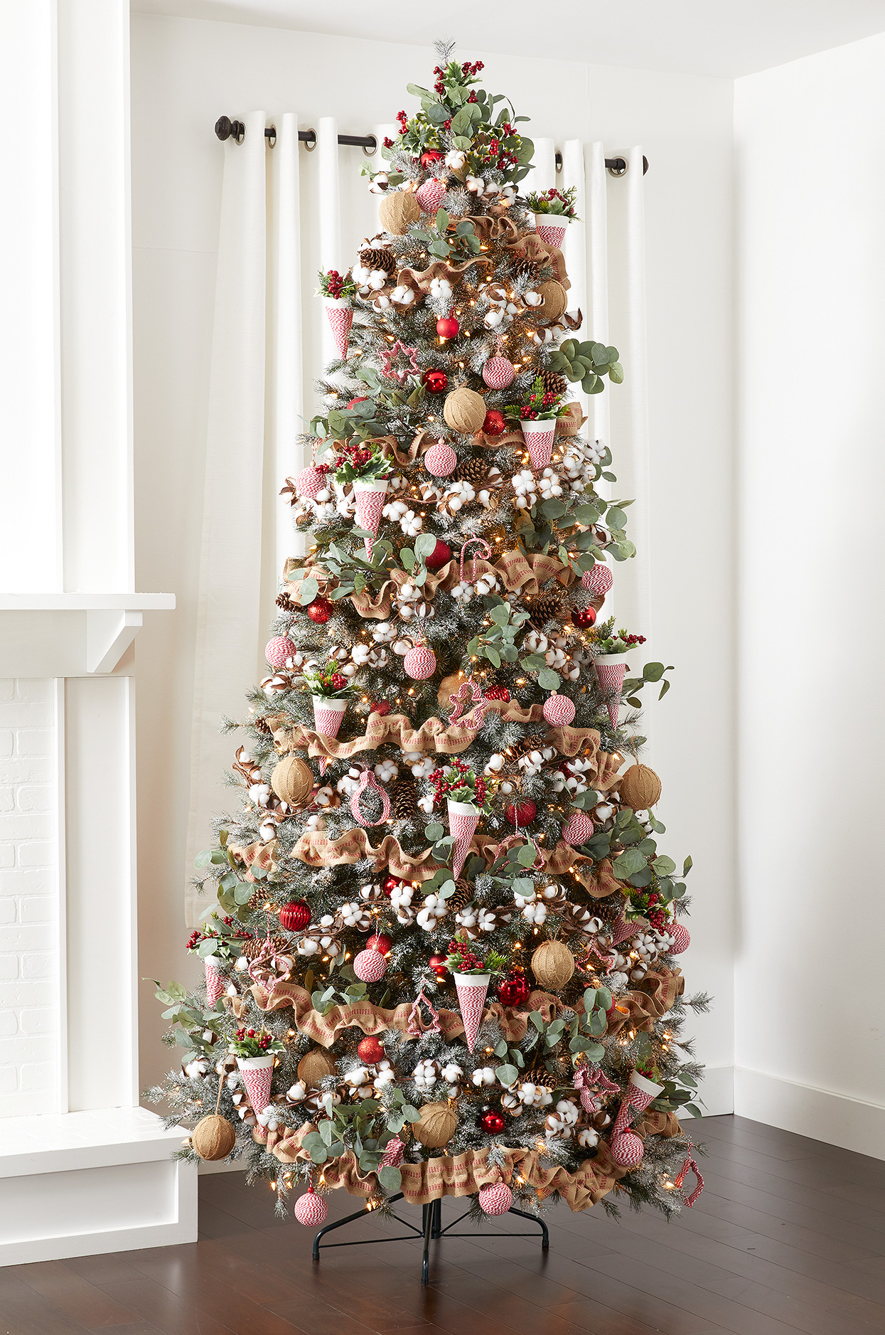 Christmas tree with cotton, burlap, twine ornaments and floral picks