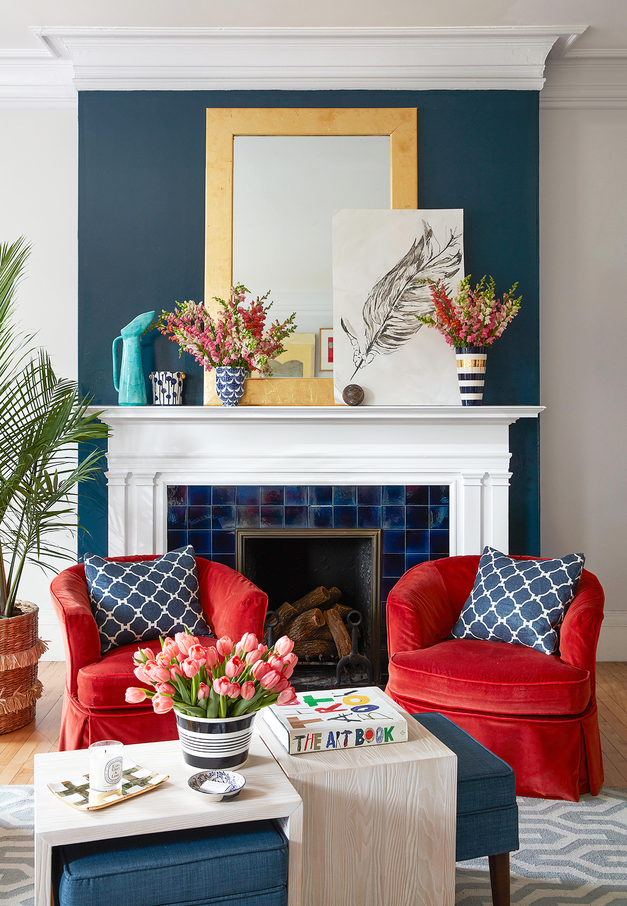 dark painted wall above fireplace with red and blue décor