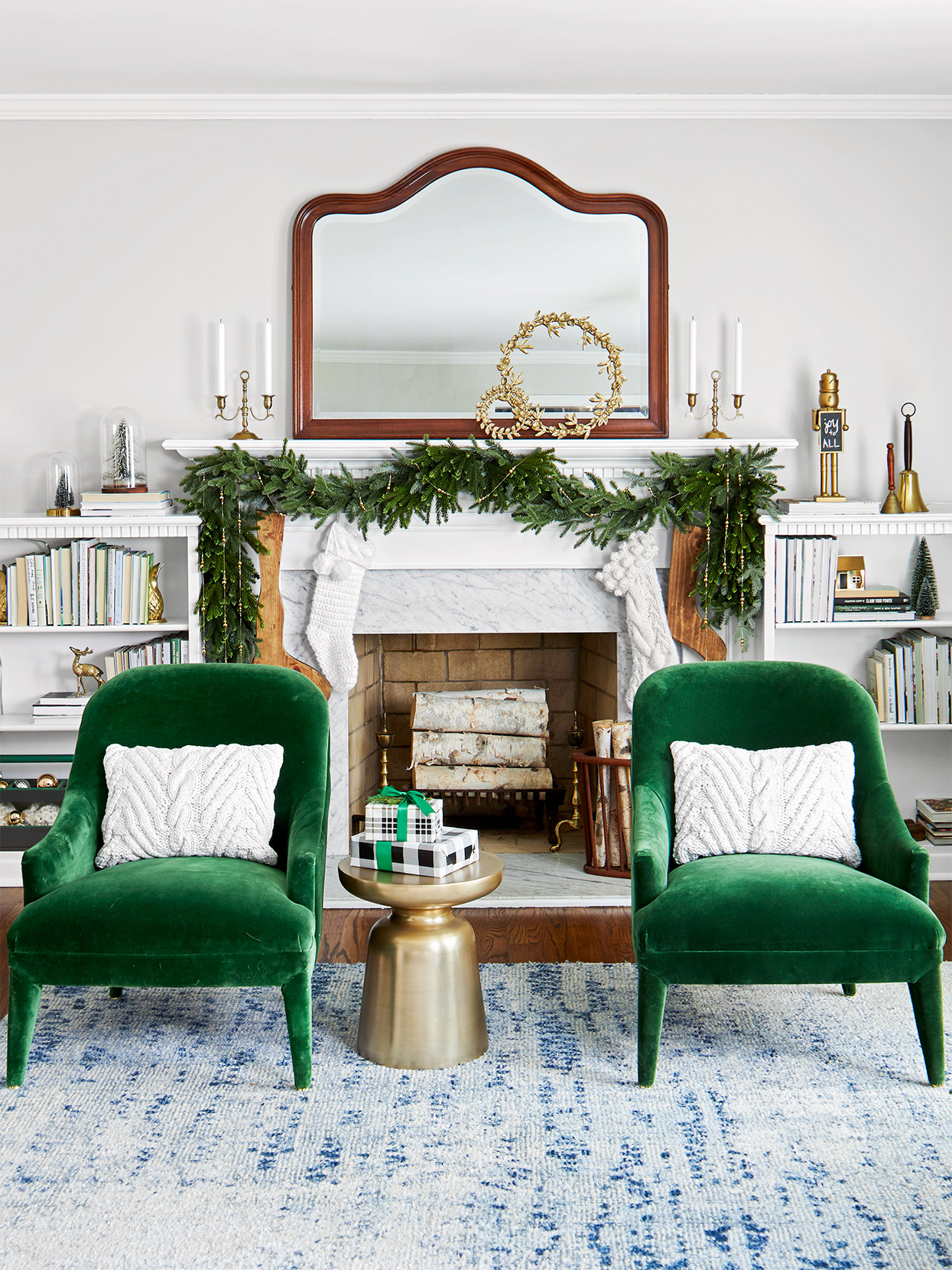 emerald green chairs near Christmas-decorated mantel