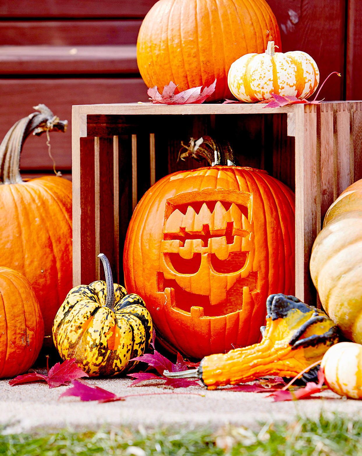 Fall décor with carved Frankenstein pumpkin