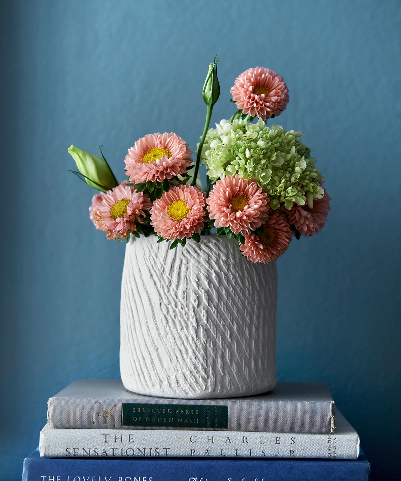 diy white textured vase with flowers on books