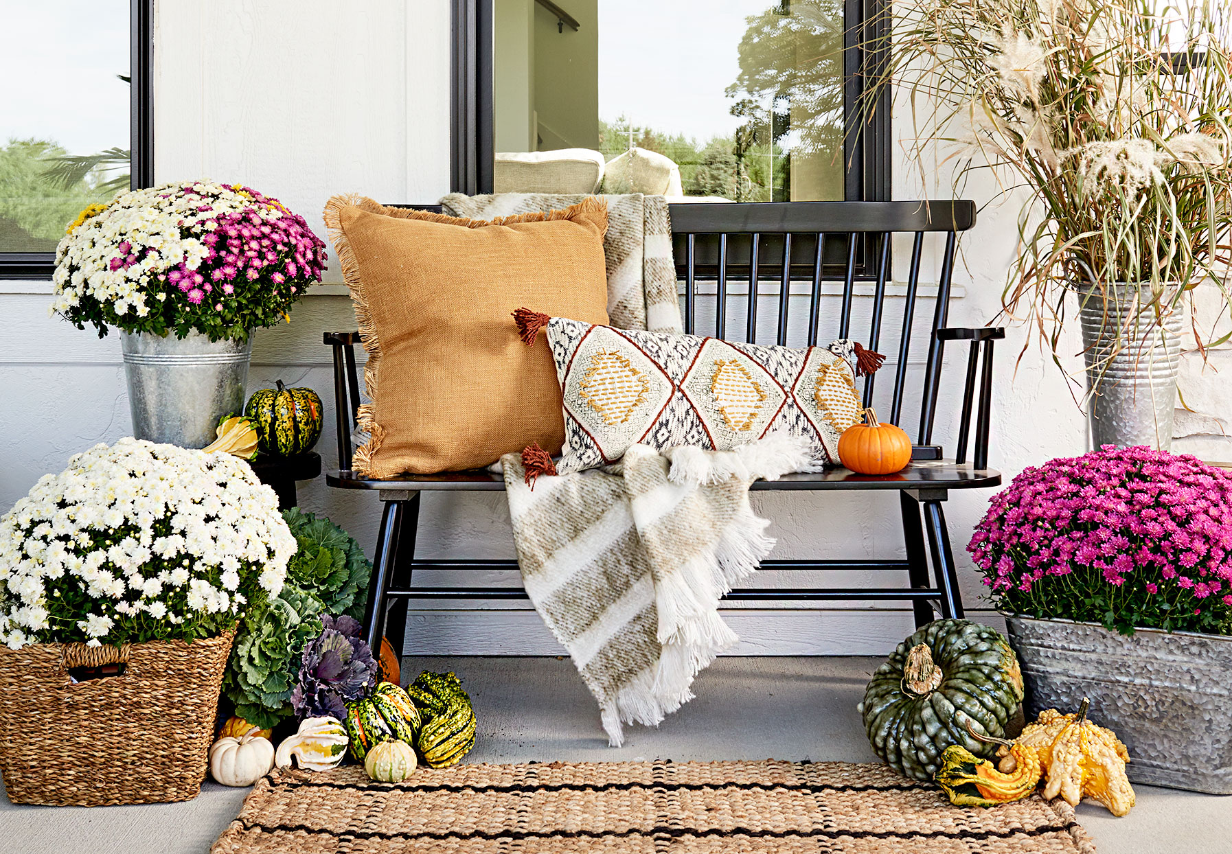 Front porch with wooden seating and flowers