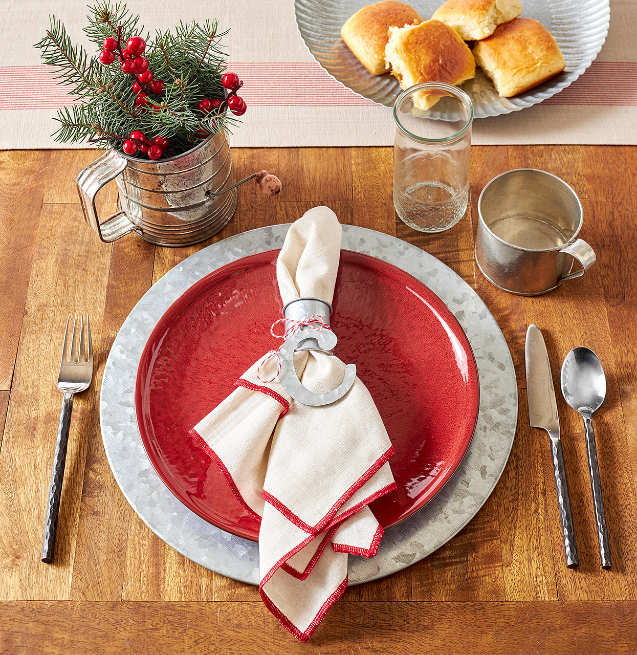 camp-inspired Christmas place setting with metal charger and sifter