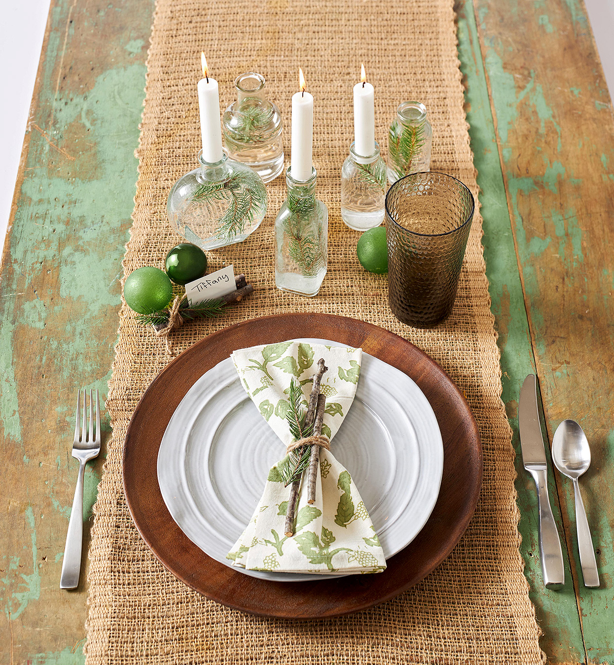 nature-inspired green Christmas place setting with burlap