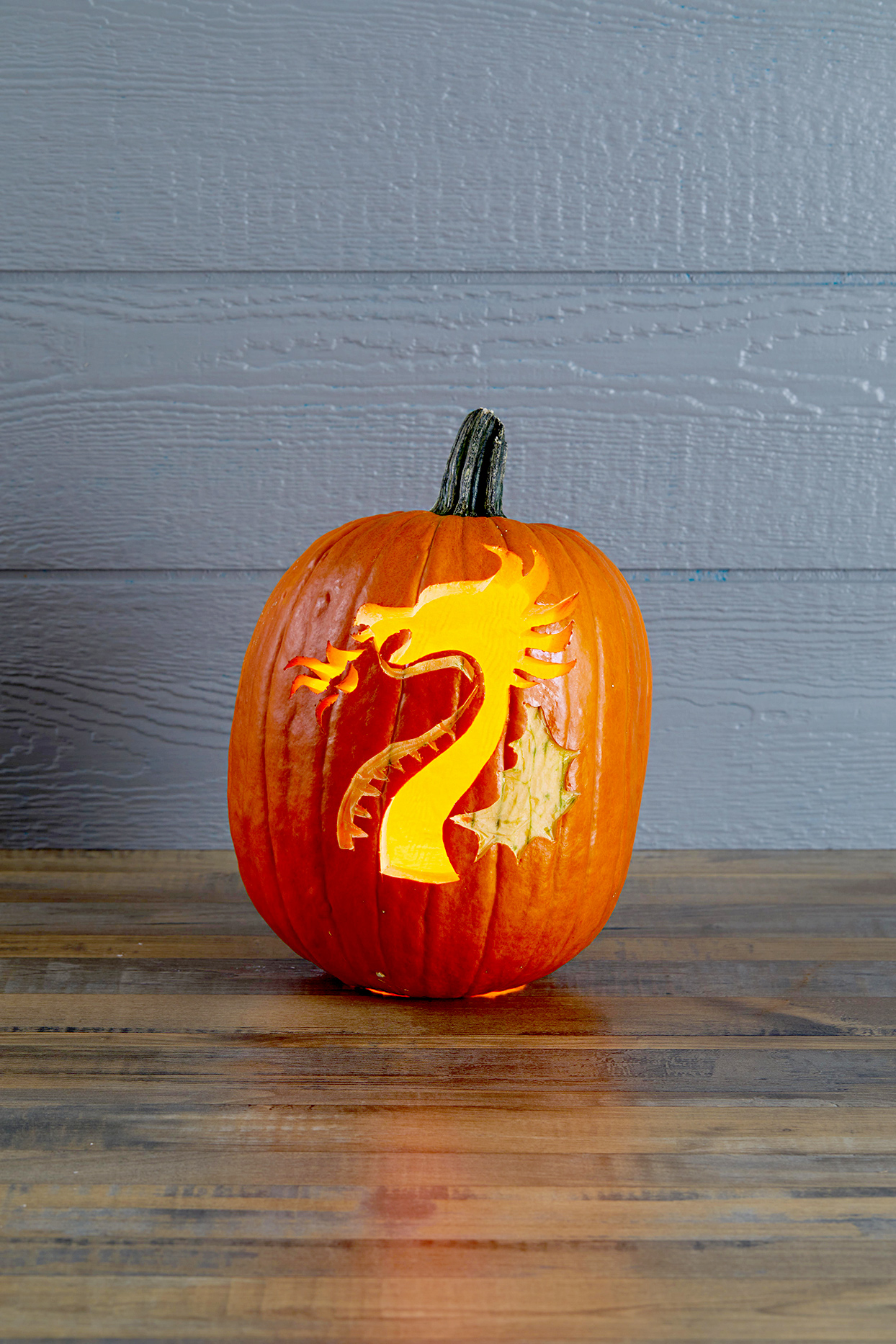 Pumpkin with dragon carving