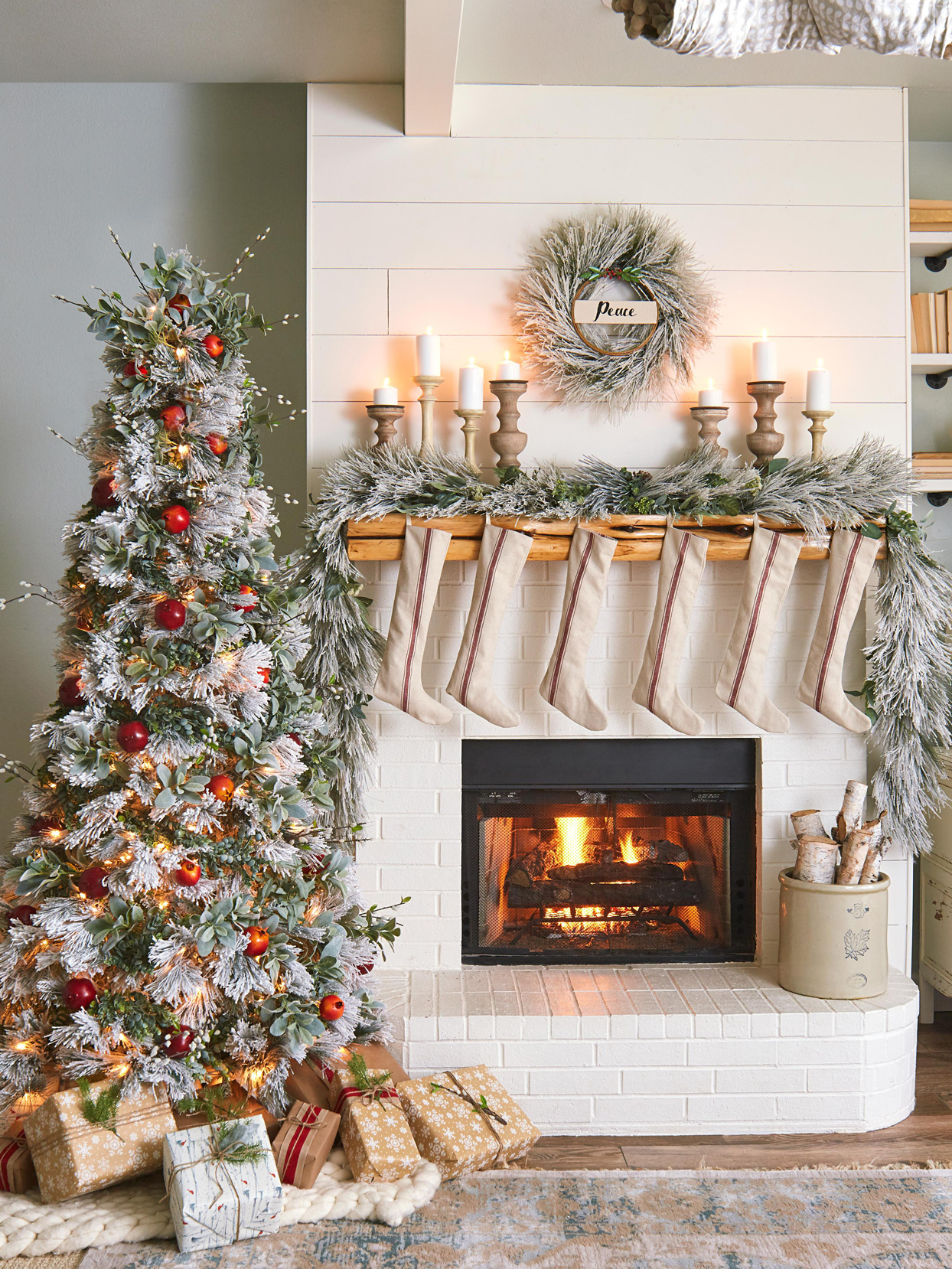 red striped stockings hanging from neutral-colored fireplace