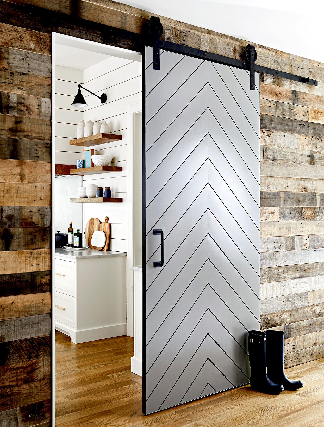 Sliding door with geometric pattern and boots