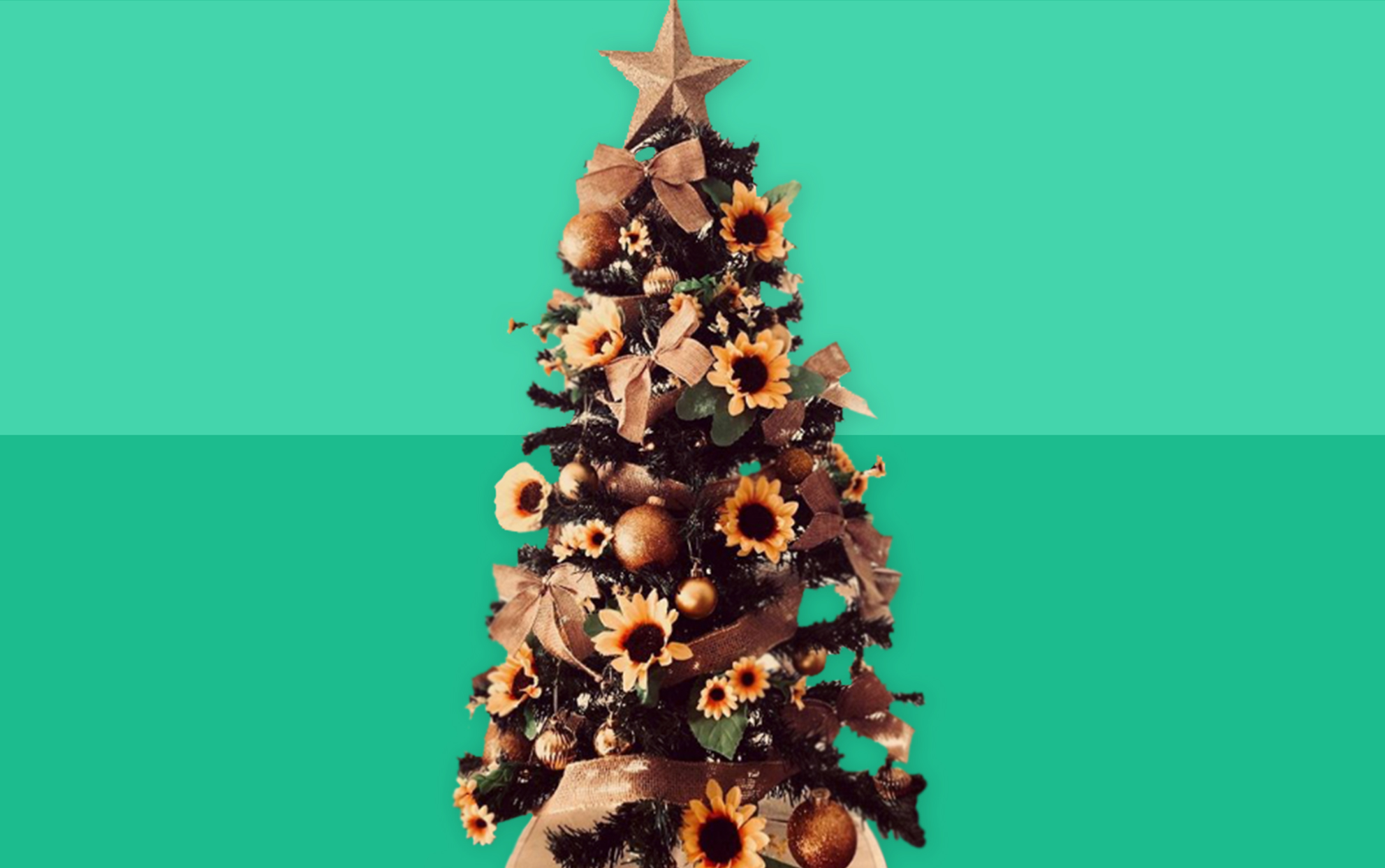 mini tree decorated with sunflowers, burlap ribbon and a gold star