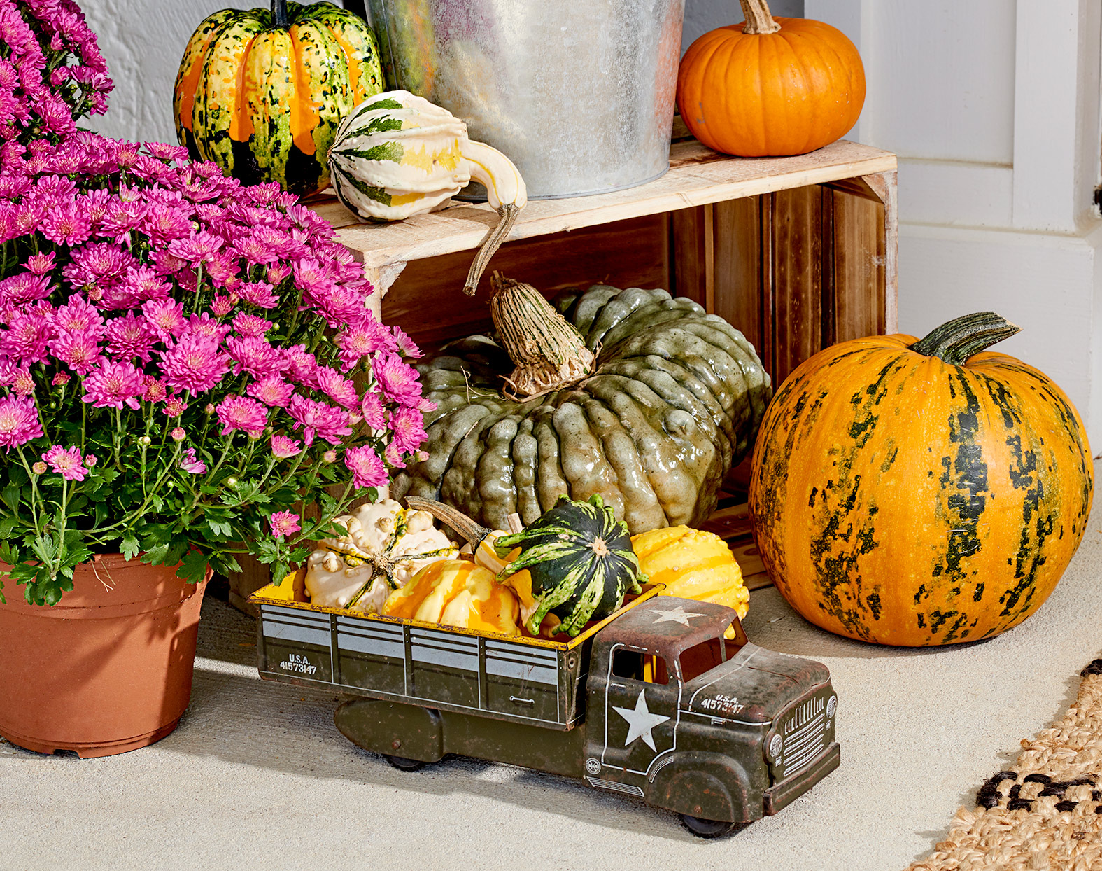 Toy truck filled with pumpkins and gourds