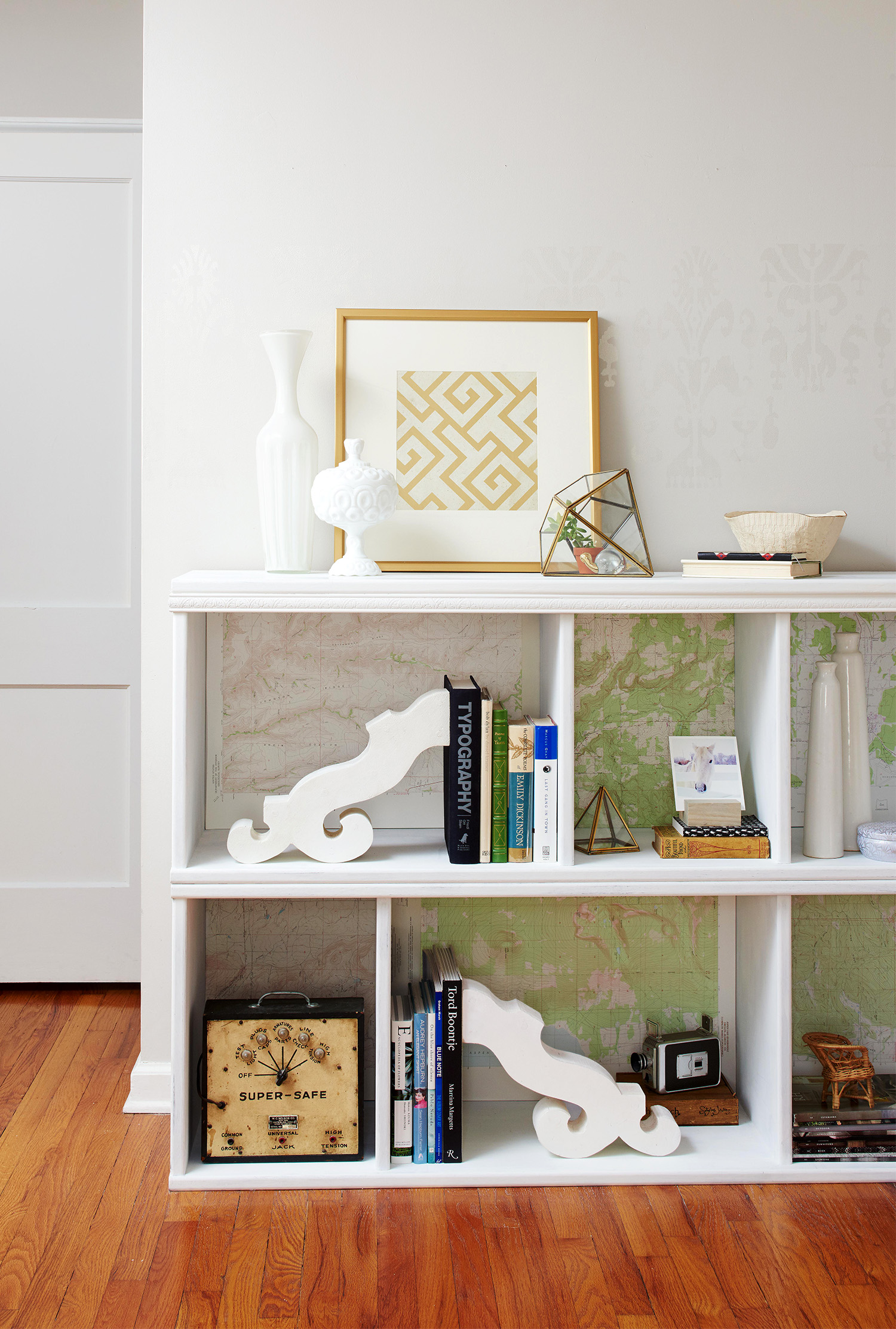 white bookcase with geometric print
