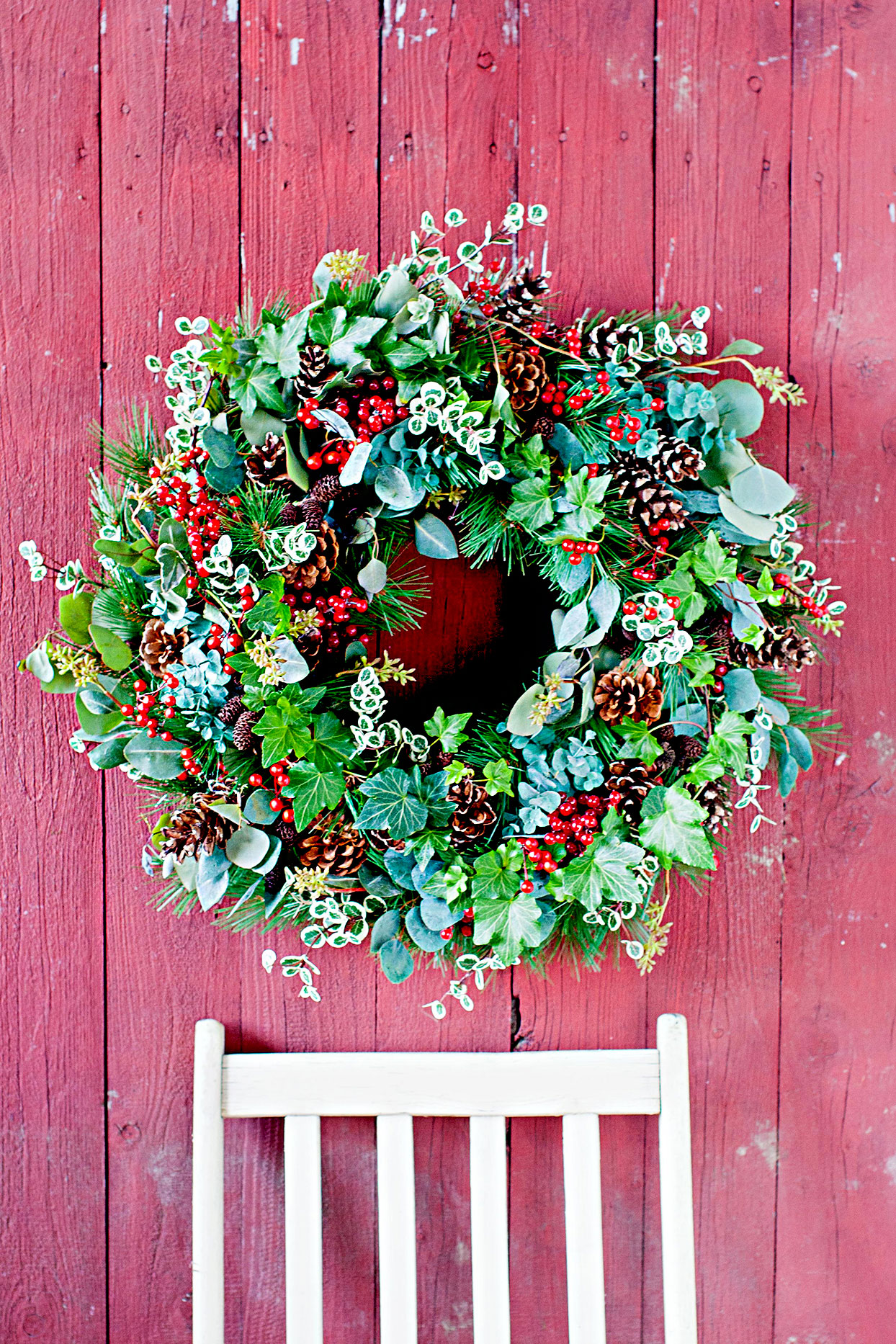 Wreath made with leaves, pinecones, and berries
