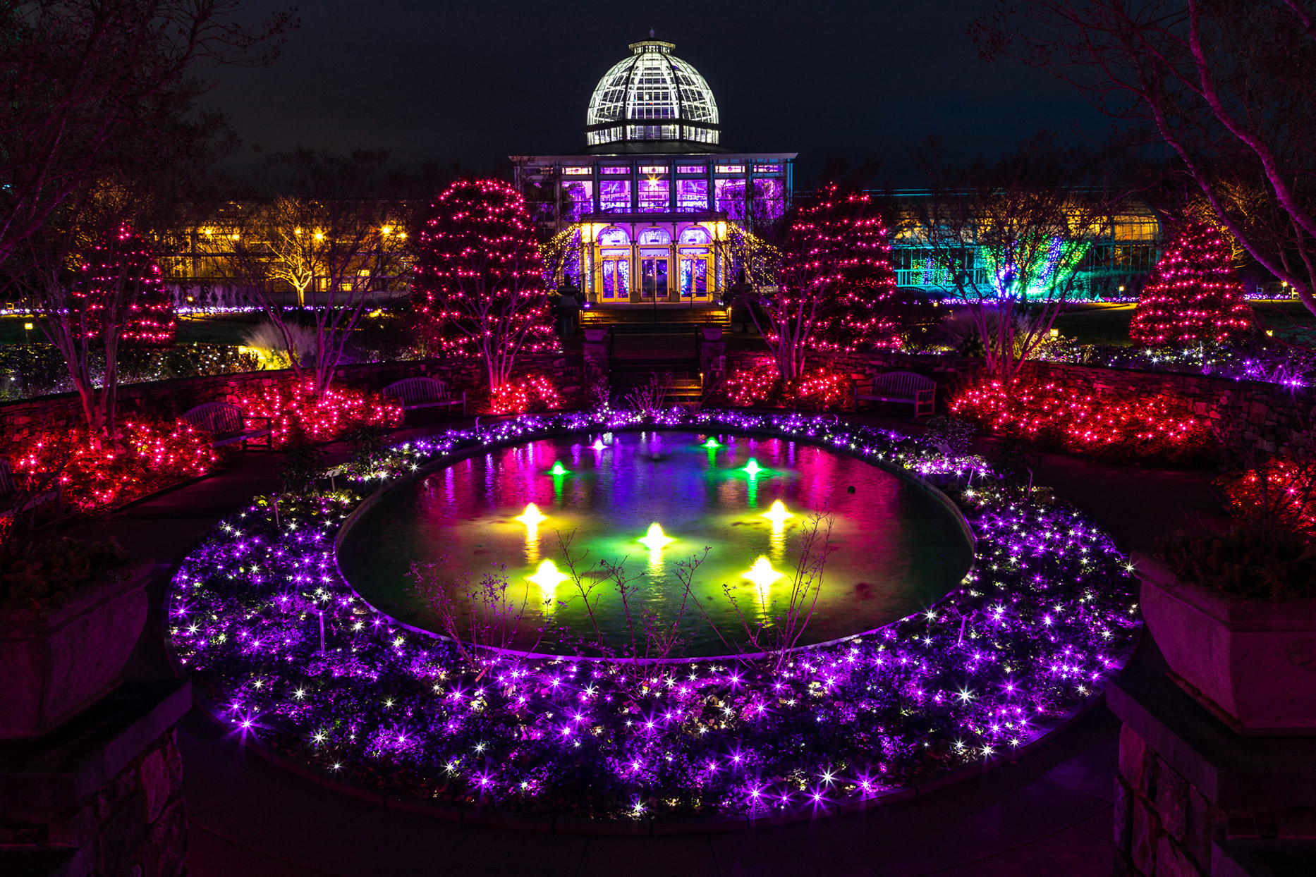 Conservatory and fountain at Lewis Ginter Botanical Garden covered with holiday lights