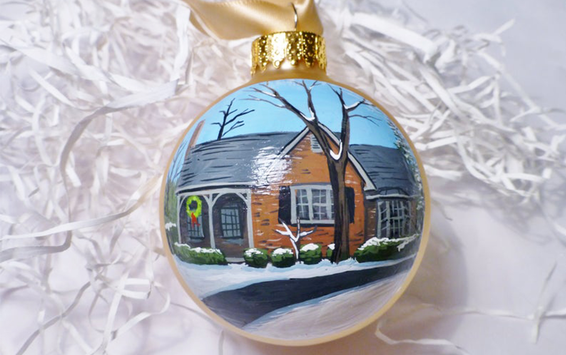painted ornament of a house with a white background