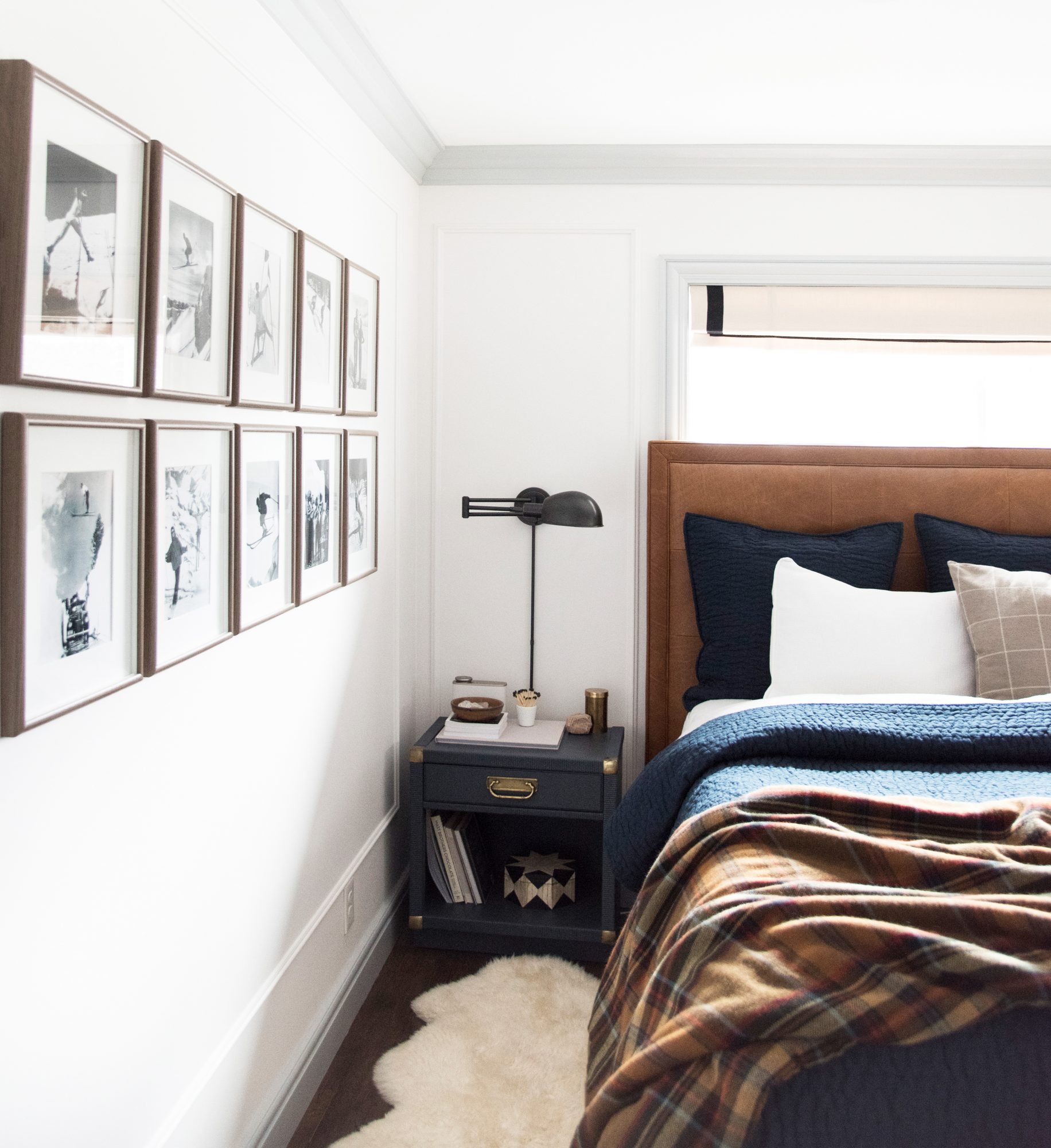 bed with nightstand and lamp in a navy and brown palette