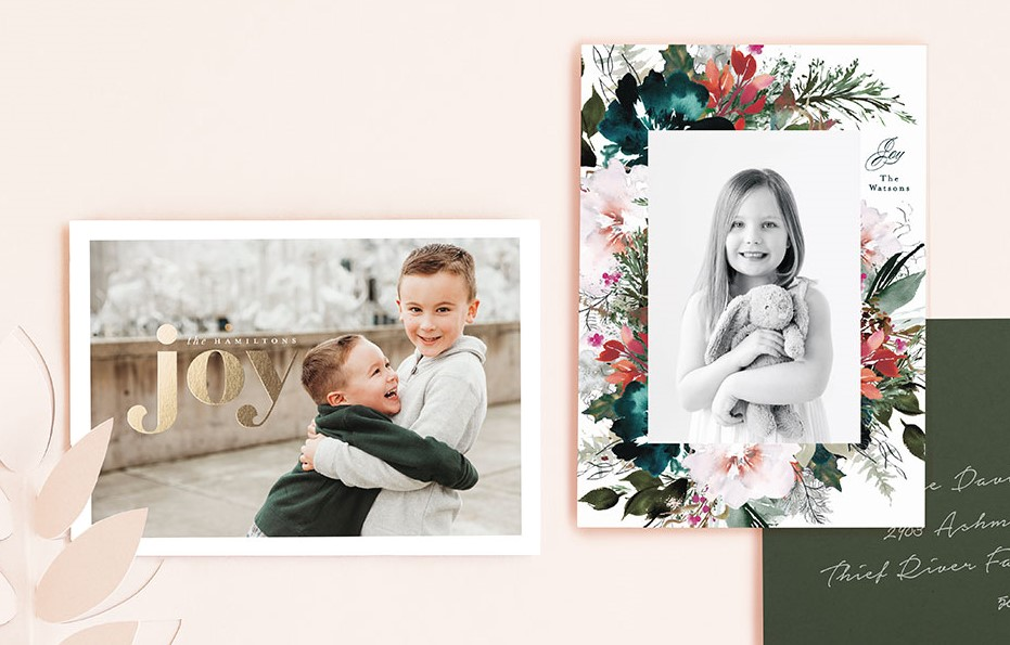 two christmas photo cards on a pink background