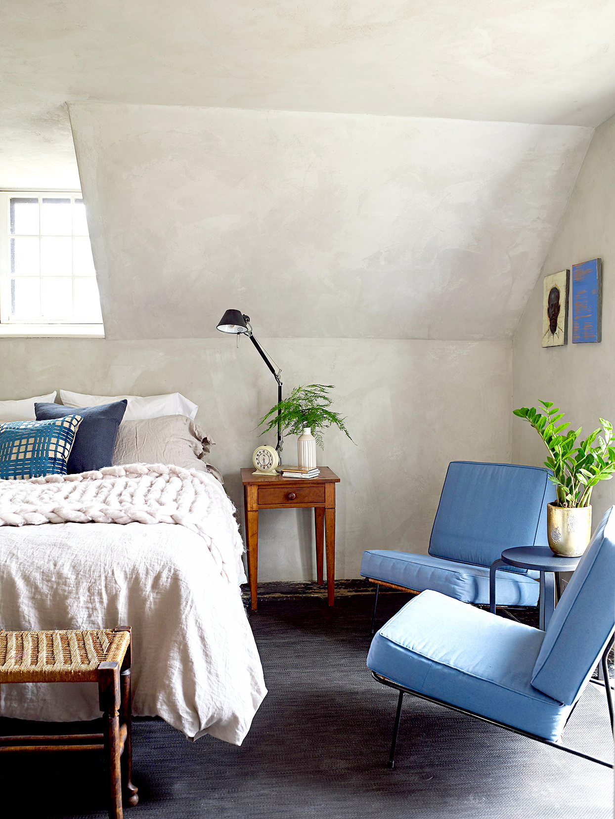 Bedroom with blue chairs and vaulted ceiling