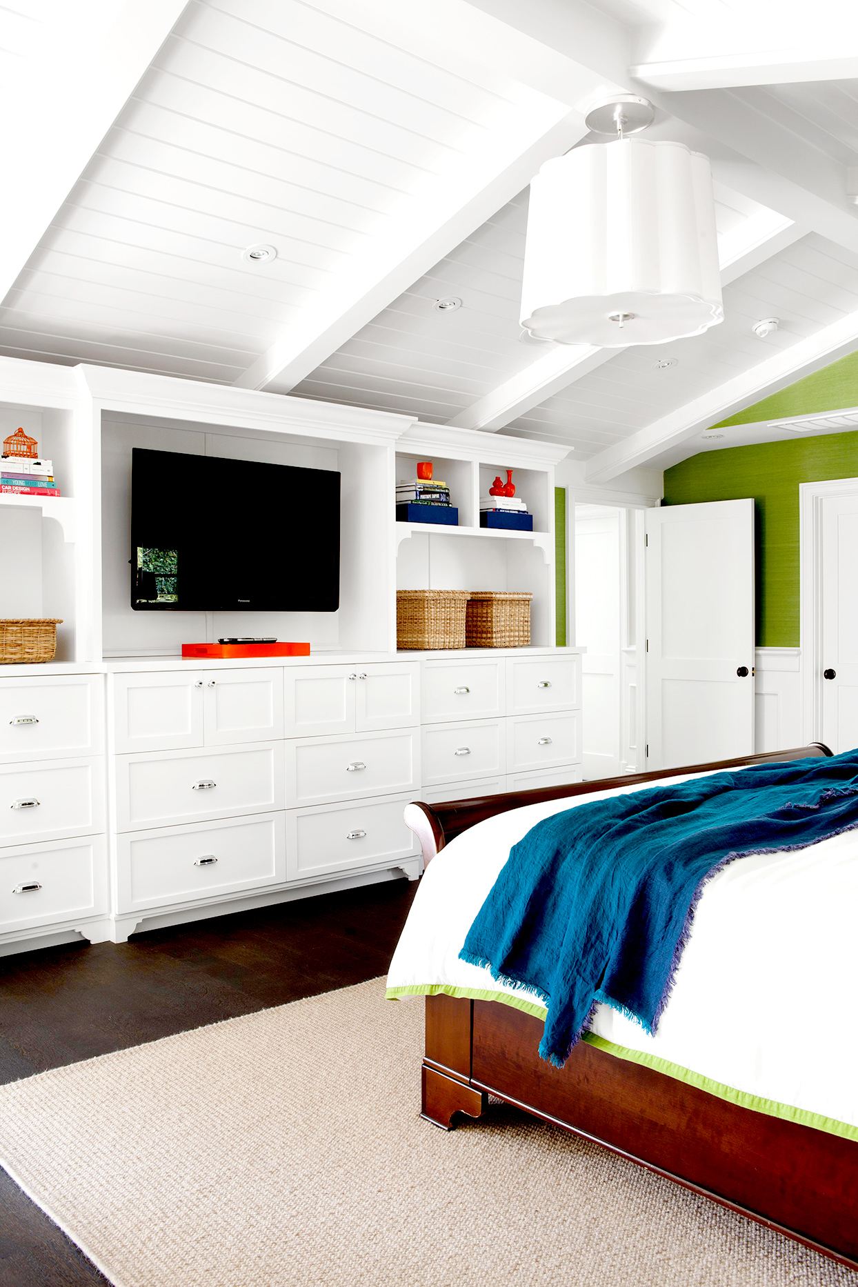 Bedroom with white cabinets and TV