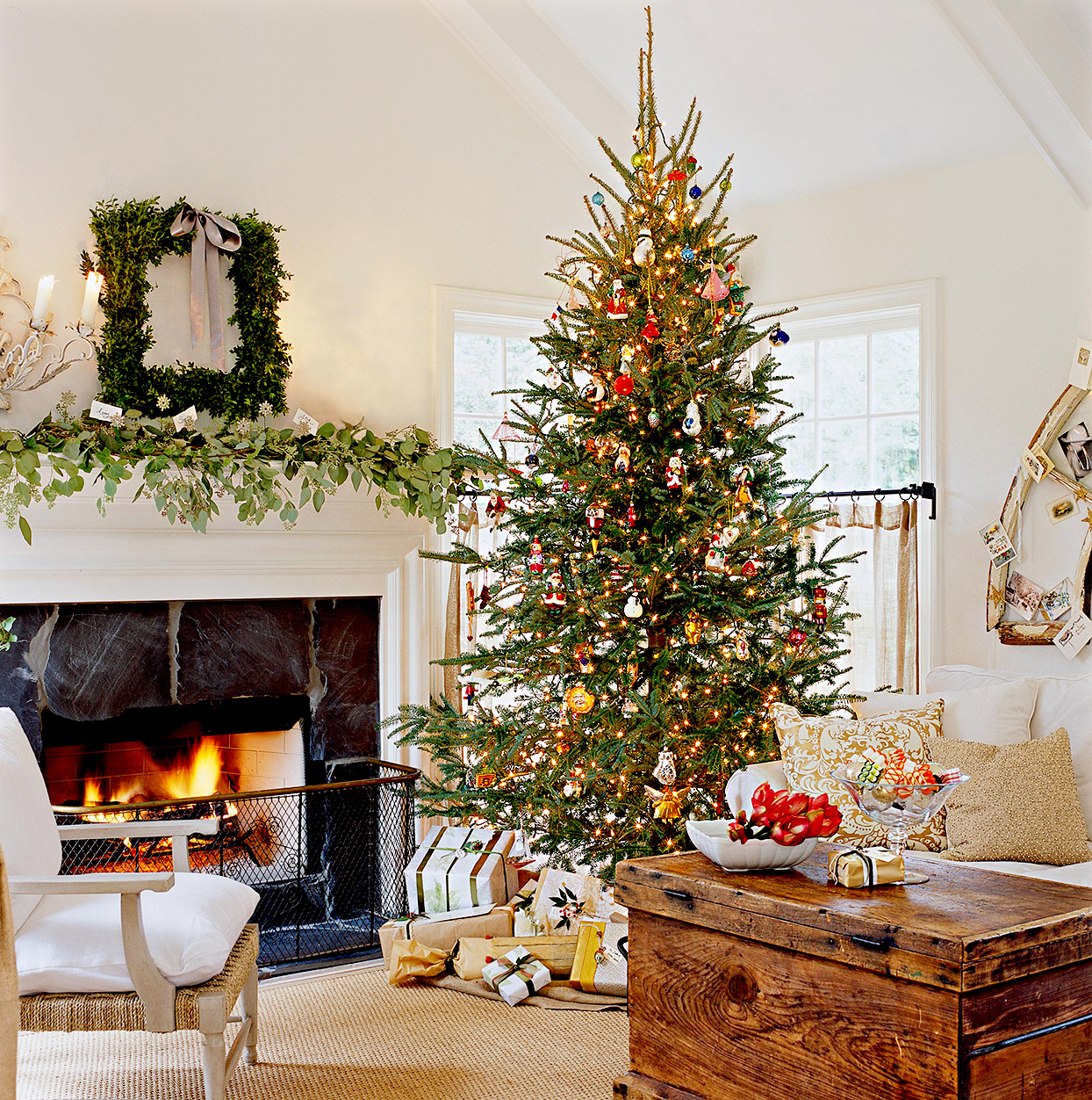 Living room with Christmas tree and decorated mantle