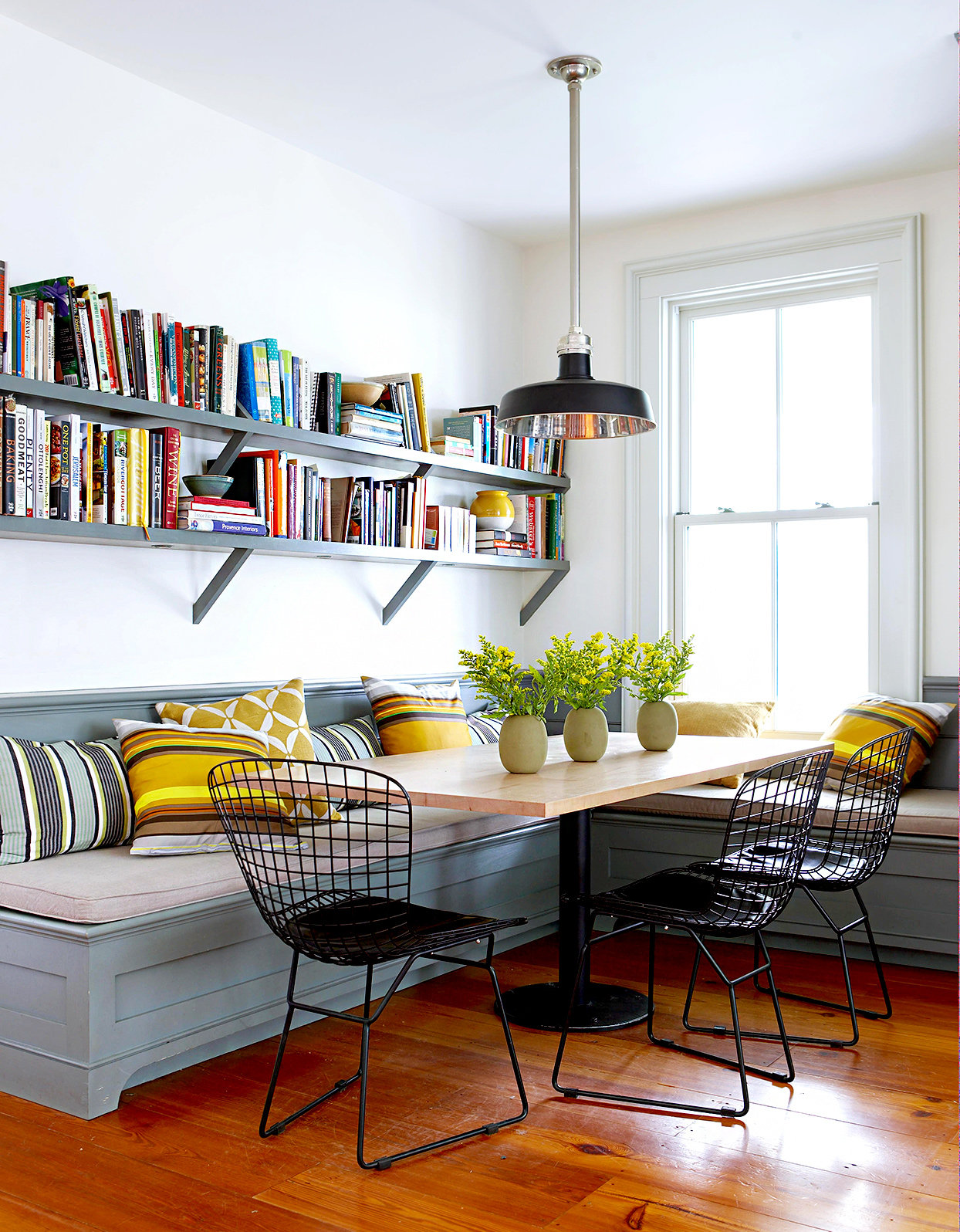 Dining area with bench seating and books