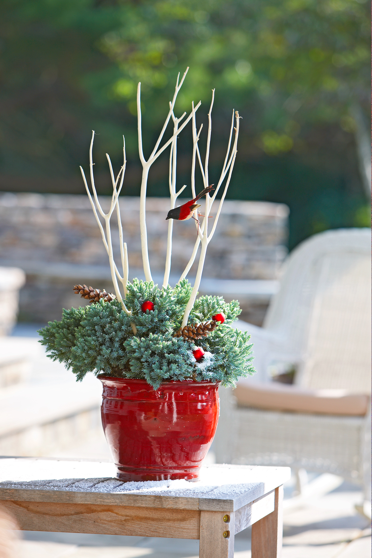 outdoor pot decorated with twigs and faux bird