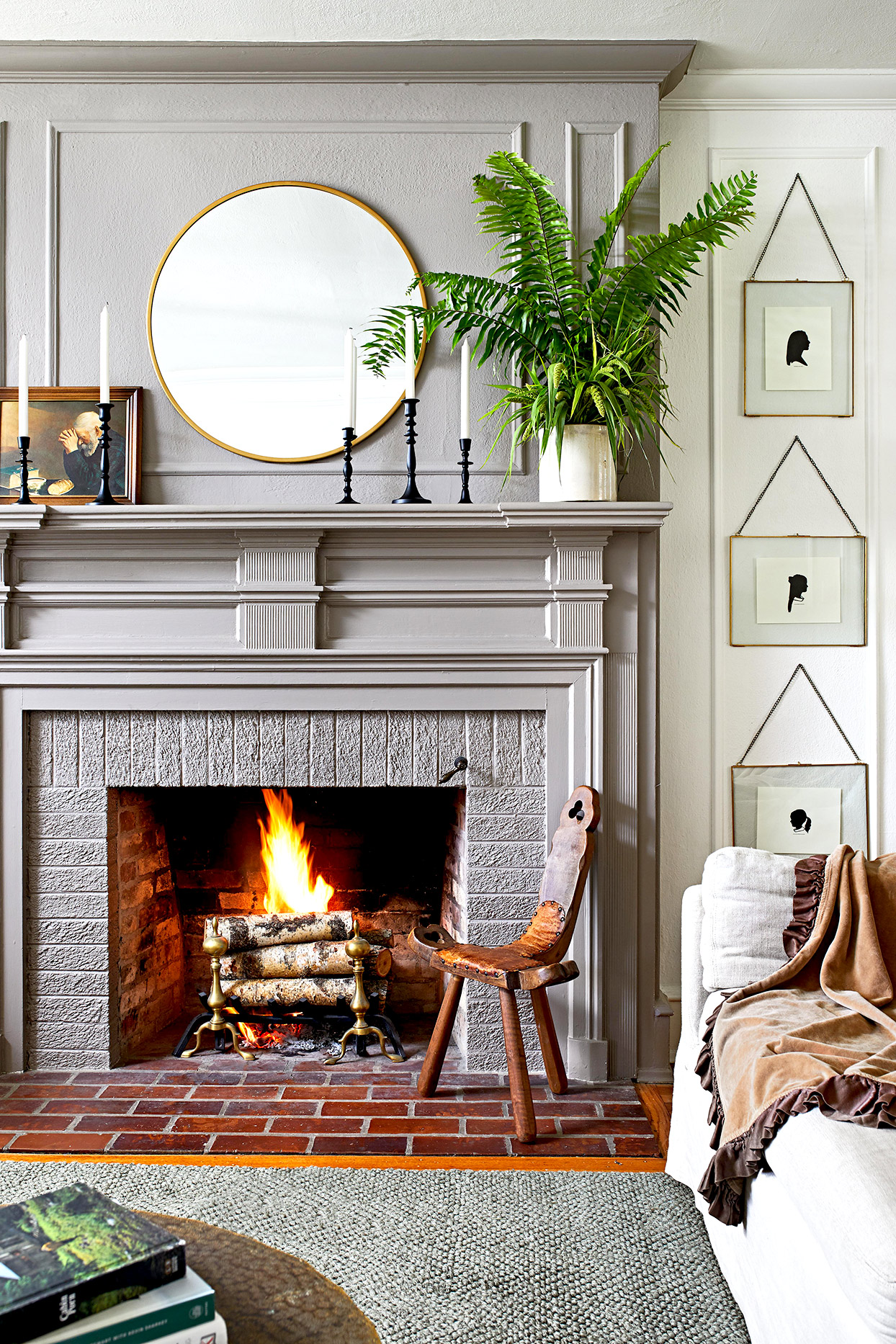 Fireplace with candles and plant