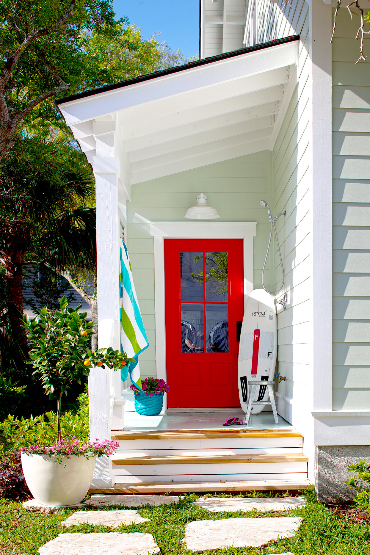 Front porch with red door