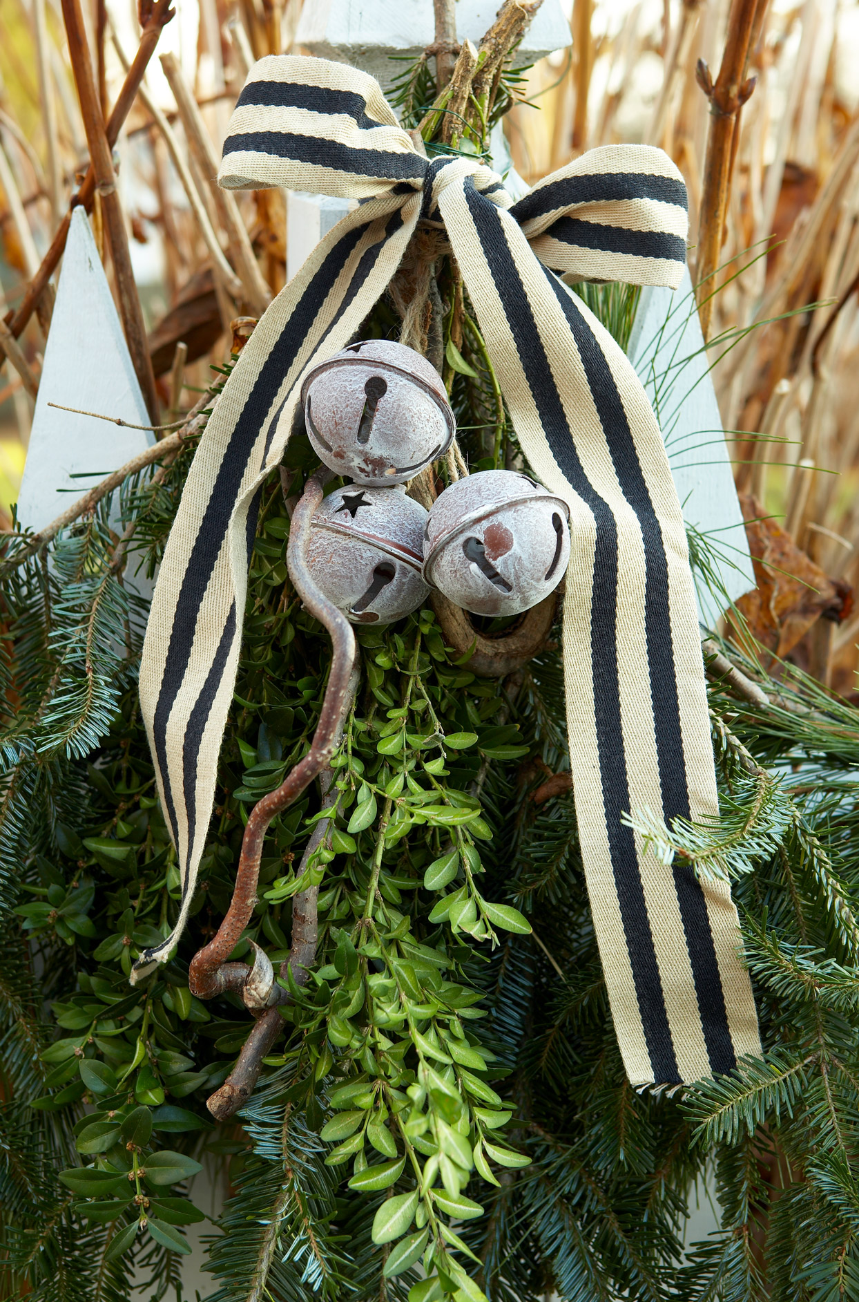 greenery decorated with jingle bells and ribbon