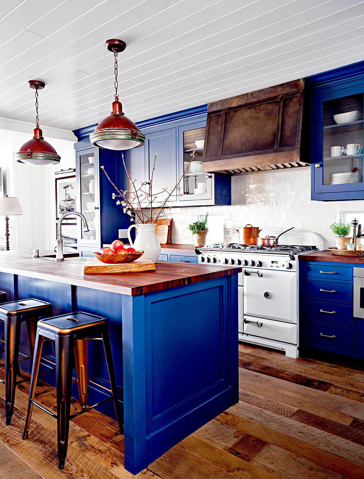 Kitchen with blue cabinets and island with seating