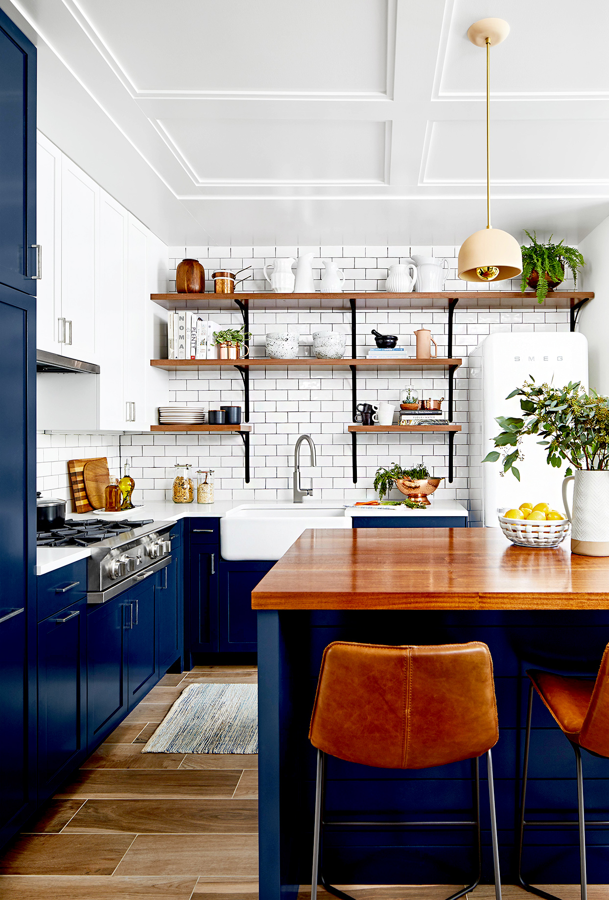 Kitchen with dark blue cabinets and wooden countertops