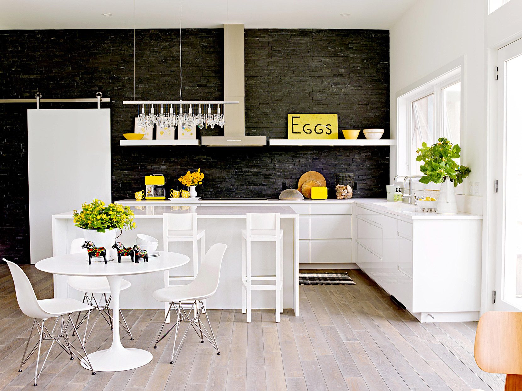 Kitchen with dark walls and white cabinets