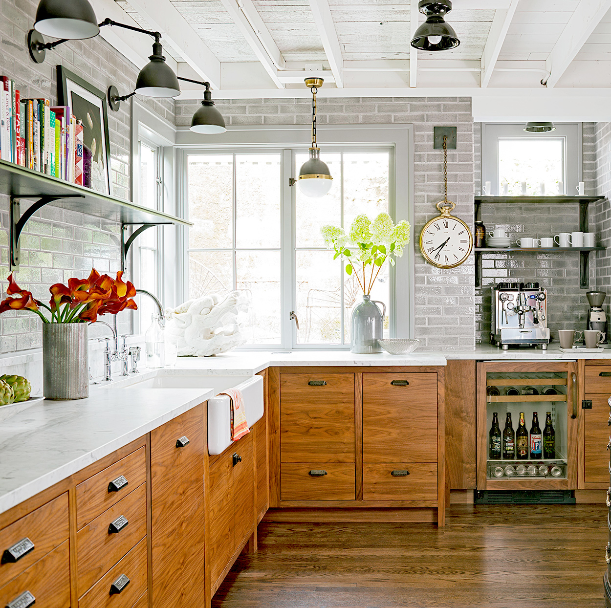 Kitchen with gray brick and wooden cabinets