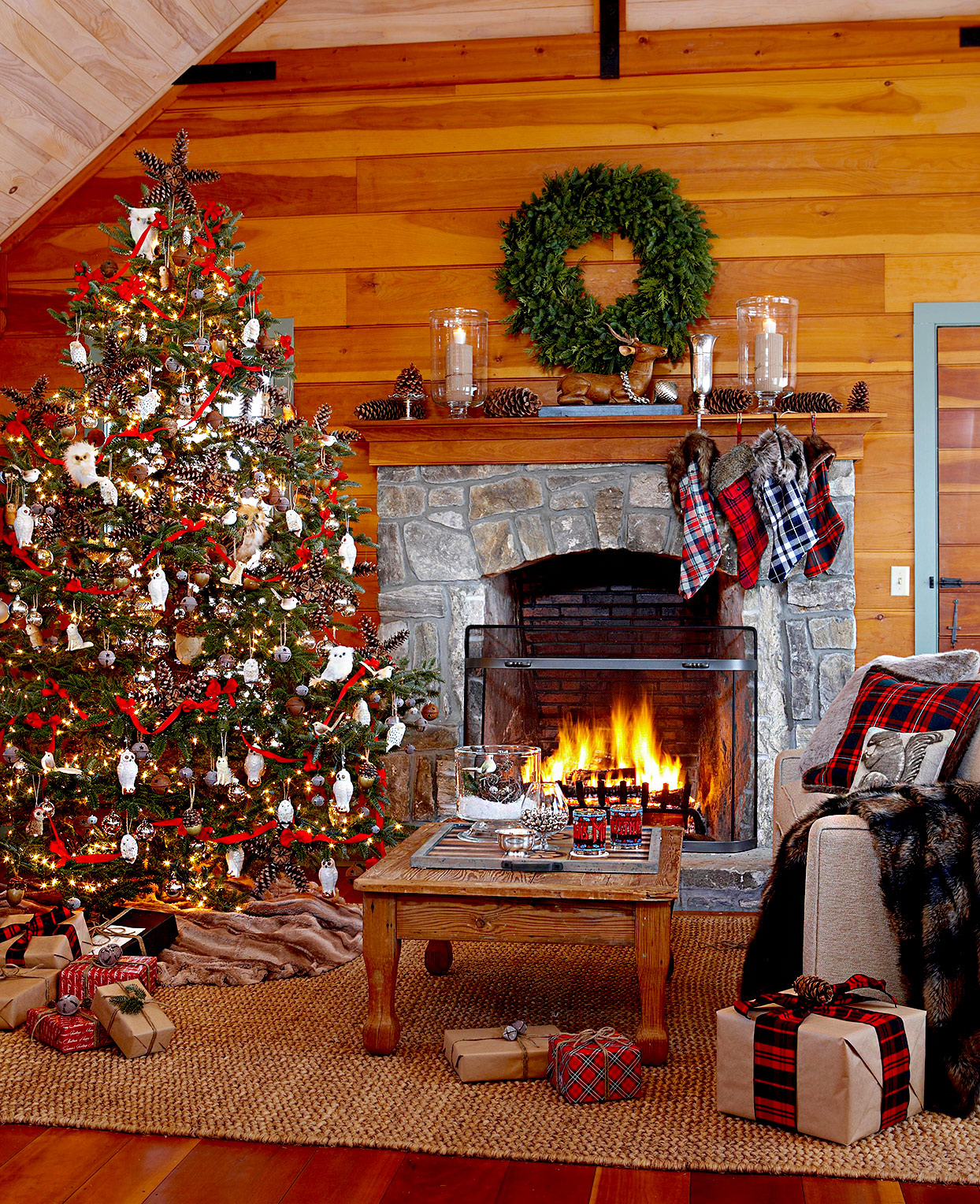 Living room with large Christmas tree and fireplace