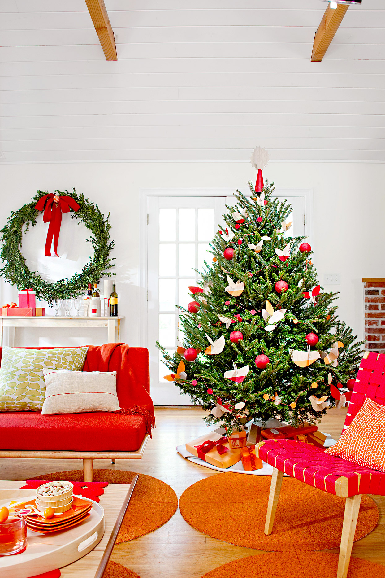 Living room with Christmas tree and large wreath