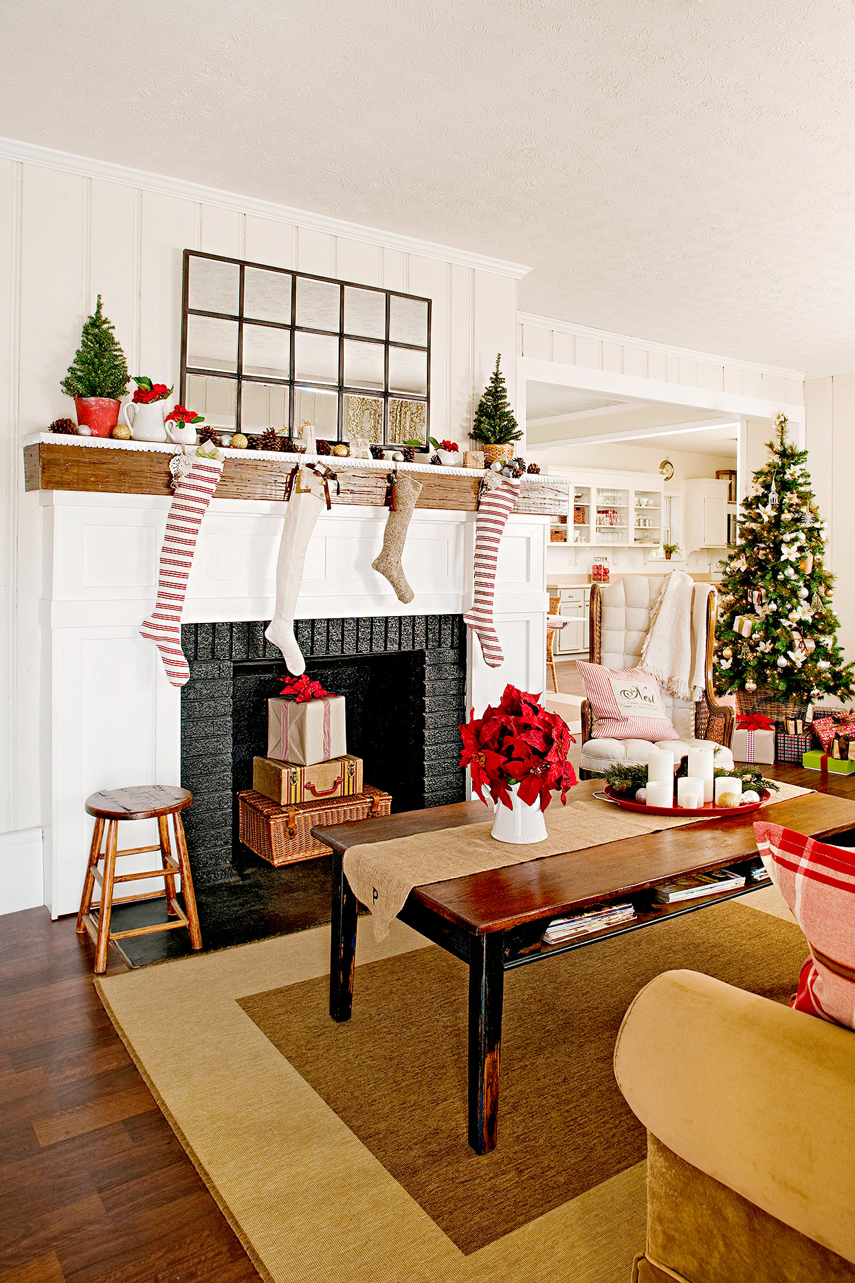Living room with gifts in fireplace and stockings
