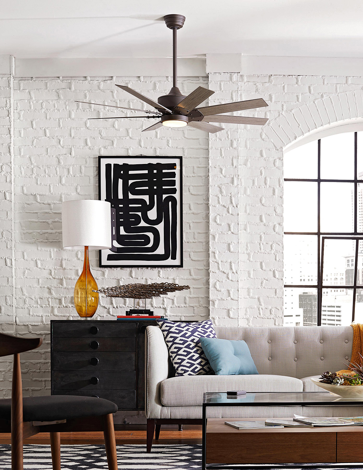 modern monochromatic living area with white painted brick