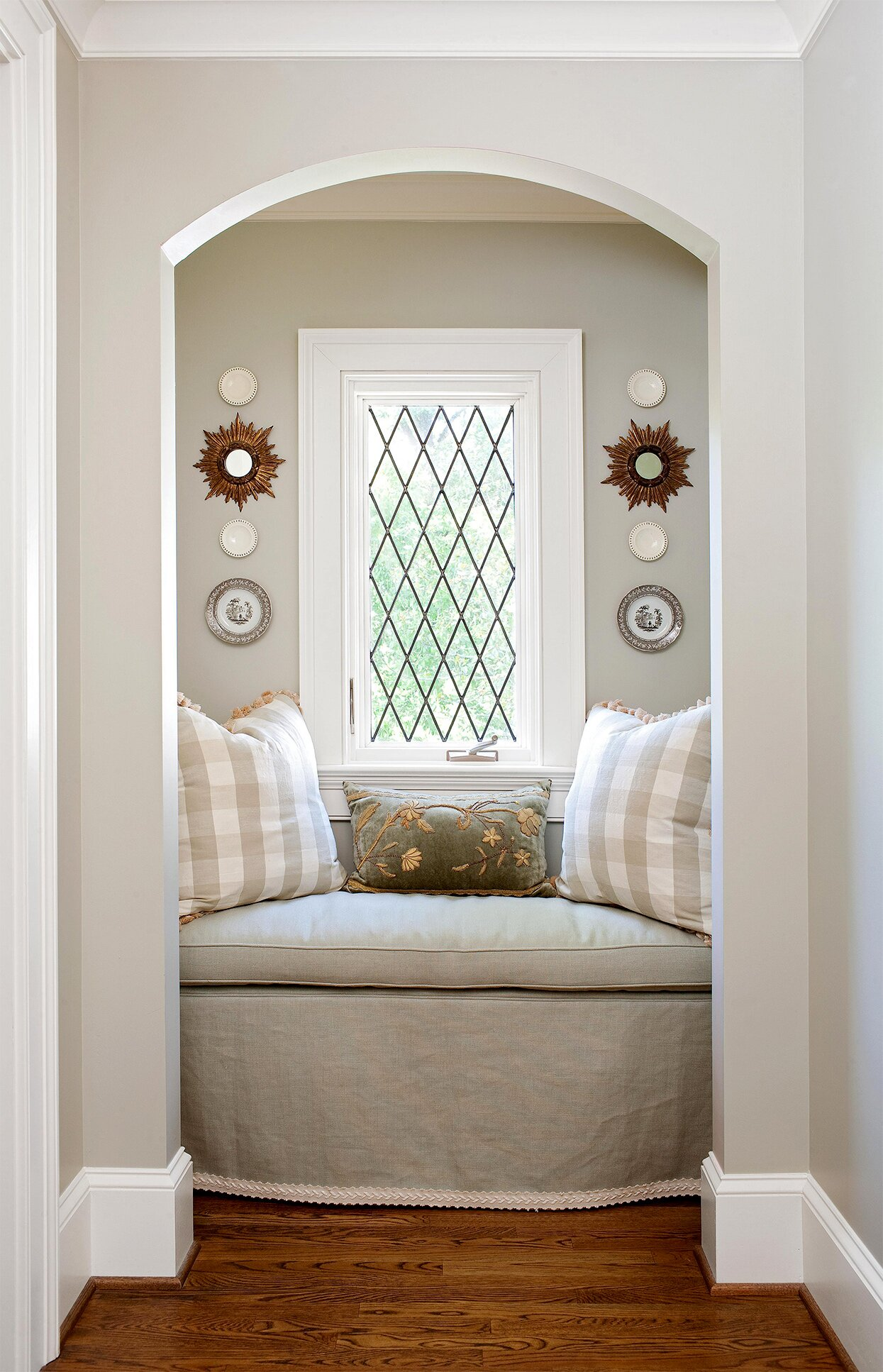 reading nook with window, neutral textiles and symmetric wall art