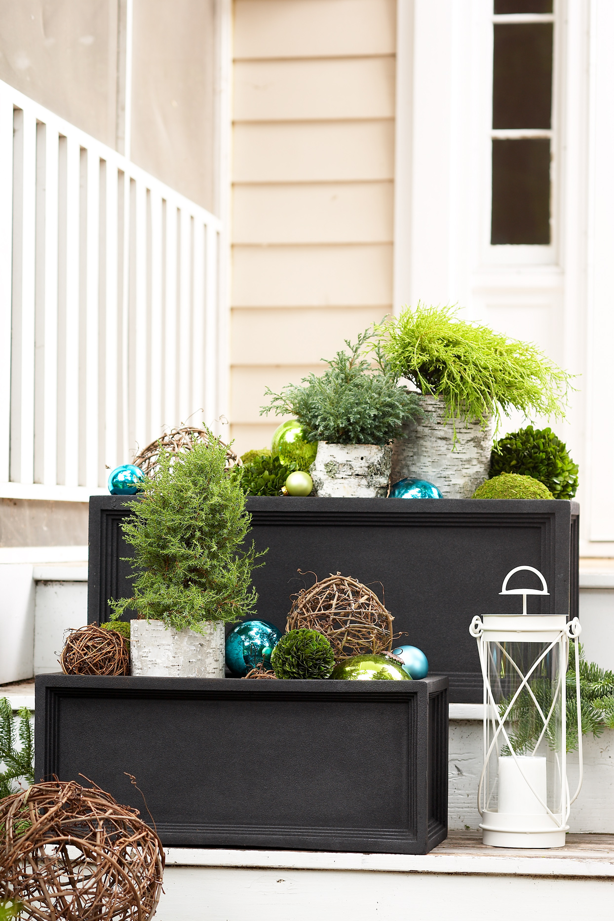 outdoor planters containing colorful ornaments and greenery