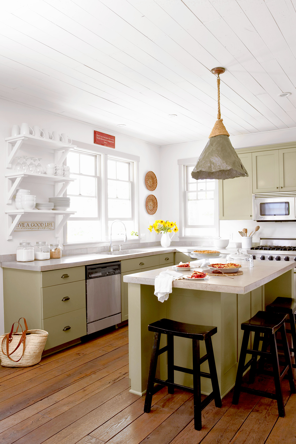 Sage kitchen with island with stools