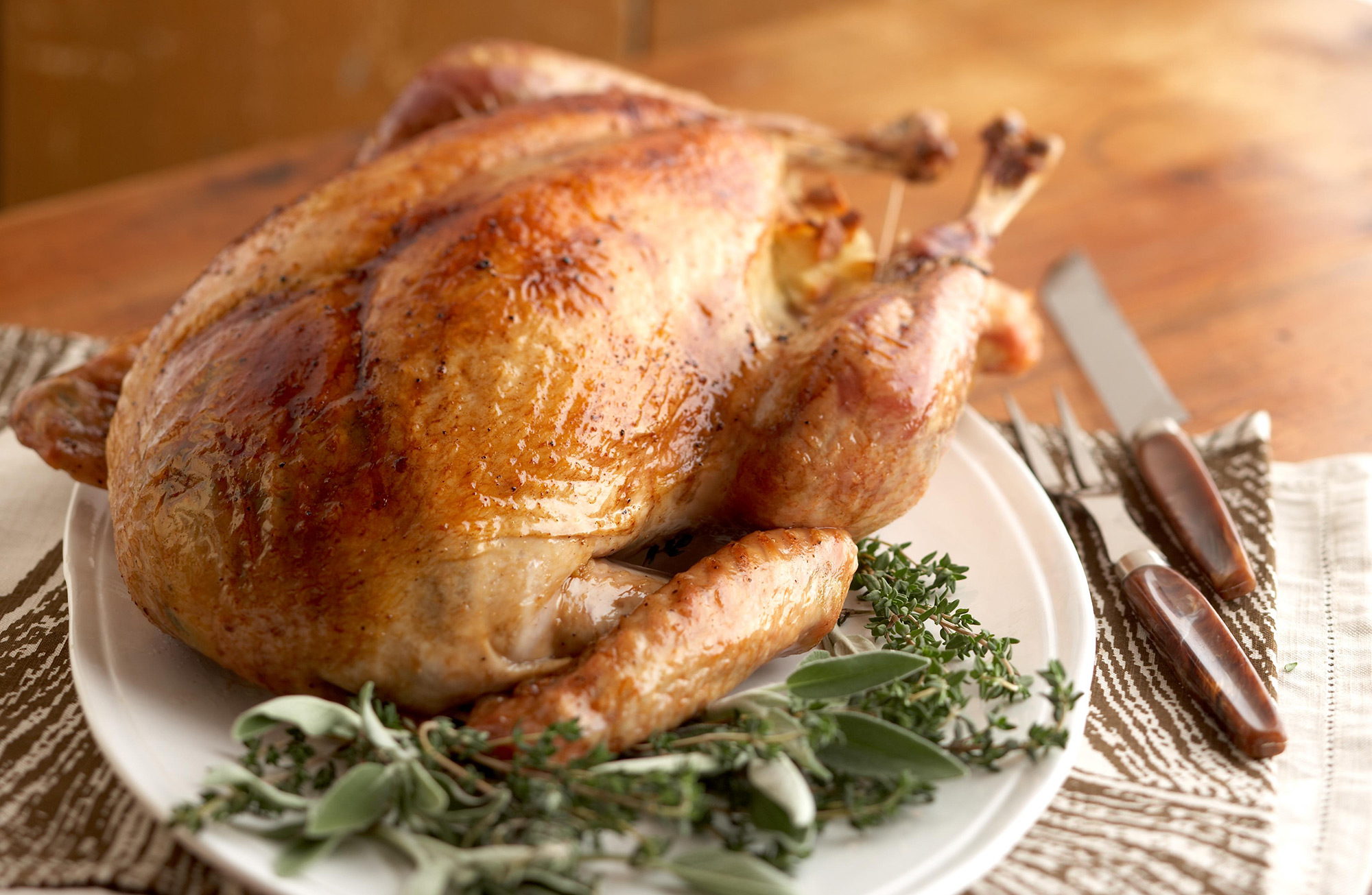 turkey on a platter with herbs