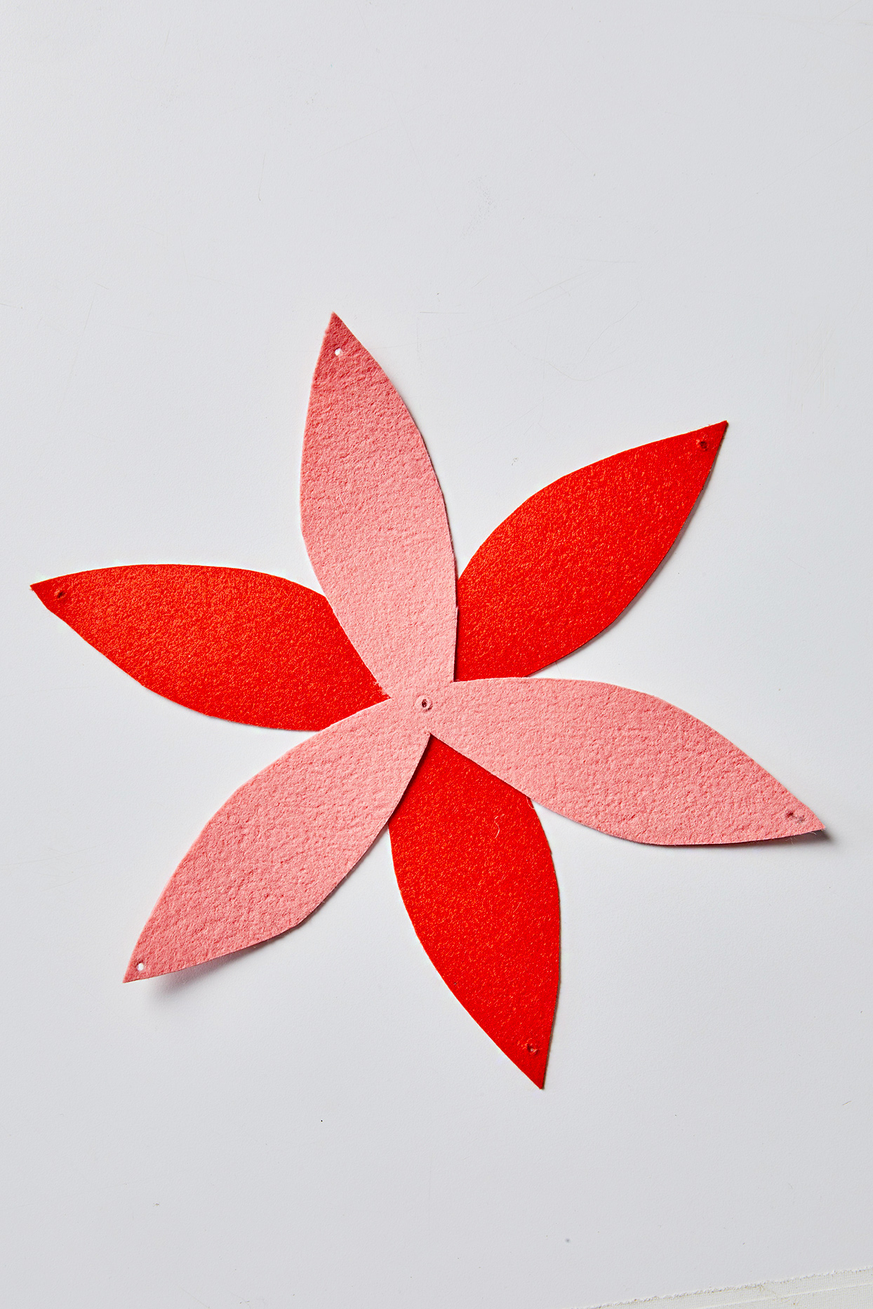 Two felt pieces in a propeller shape