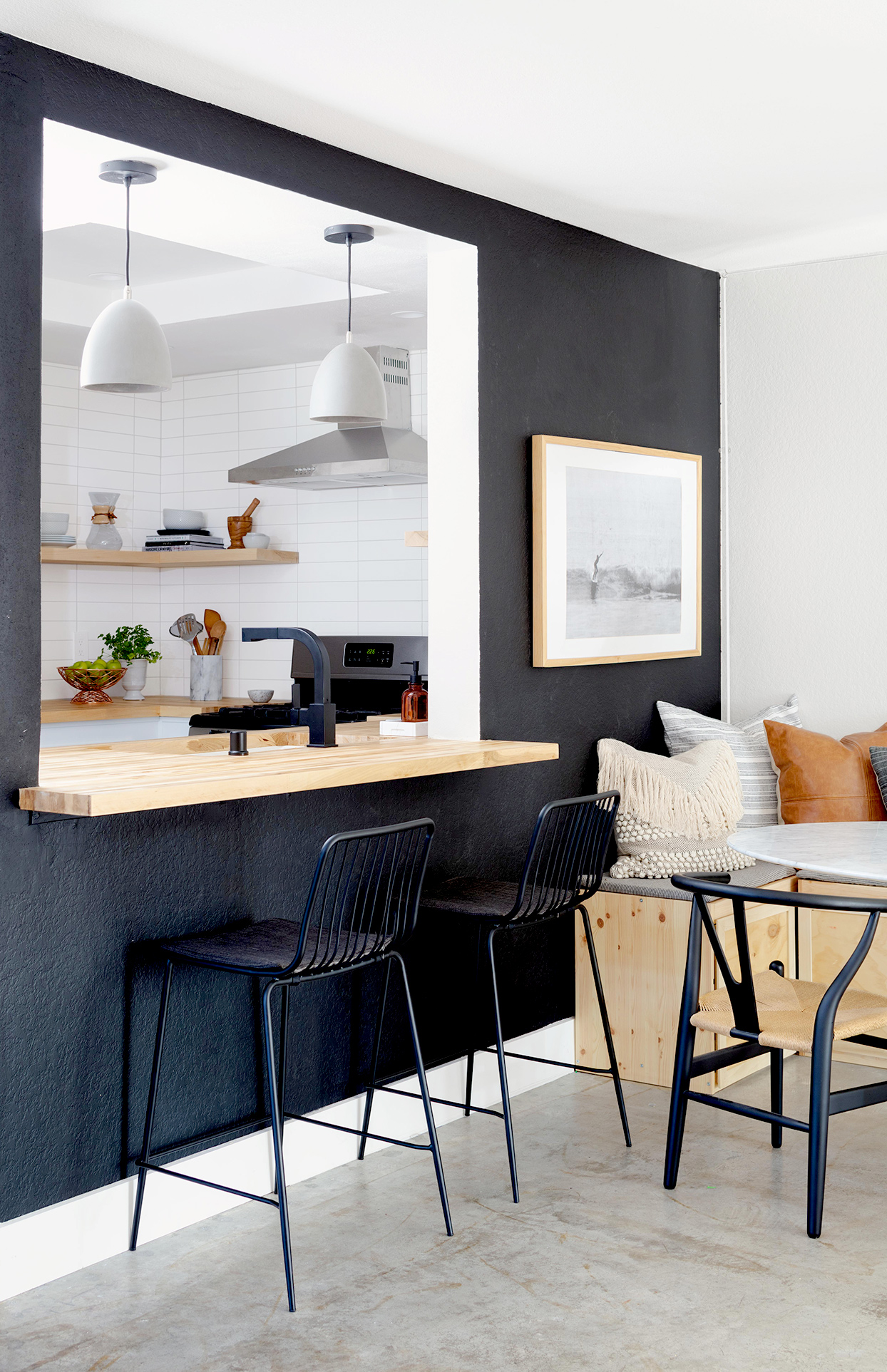 Wall cutout to kitchen with stool seating
