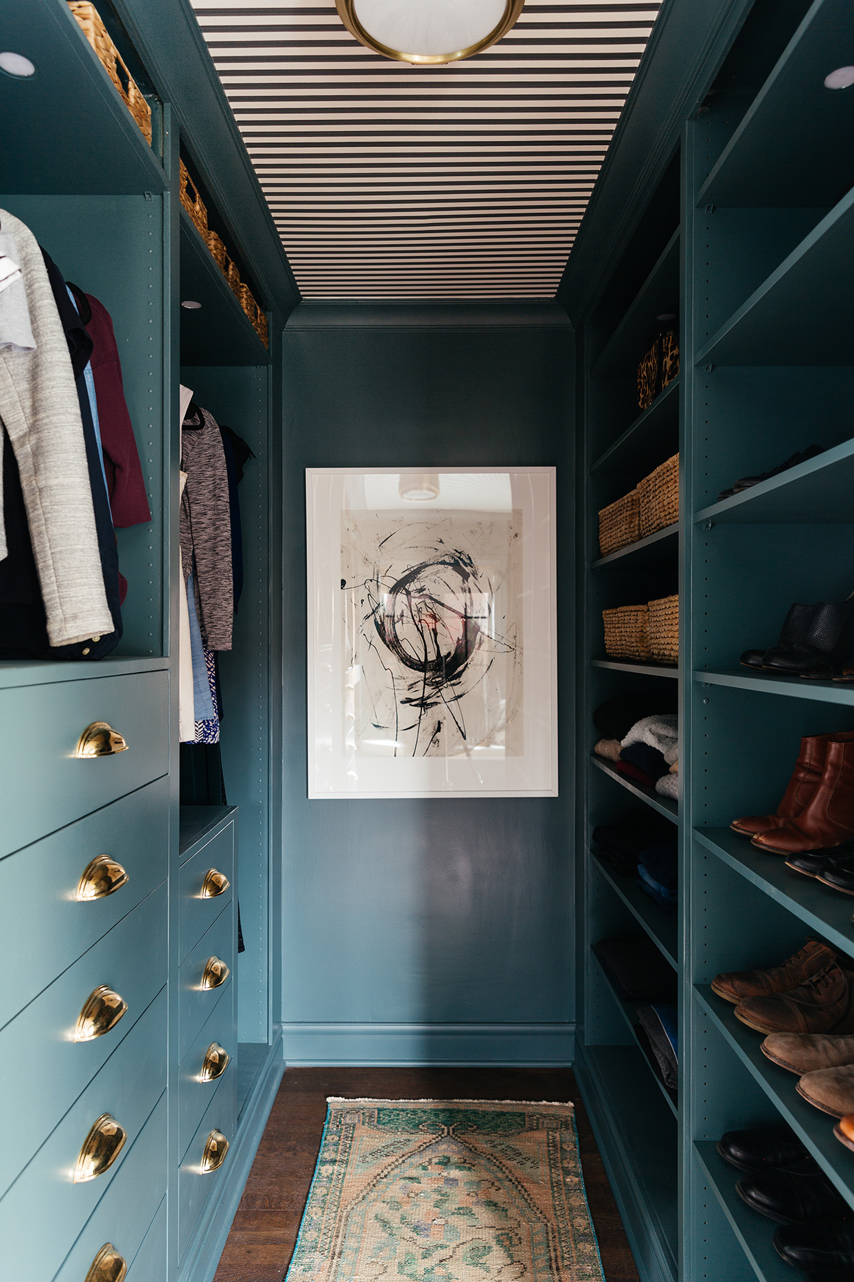 walk in closet painted deep green color