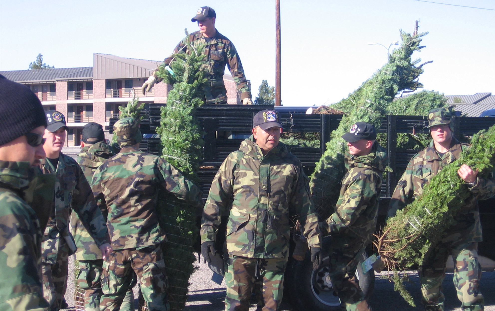 Military soldiers distributing Christmas trees